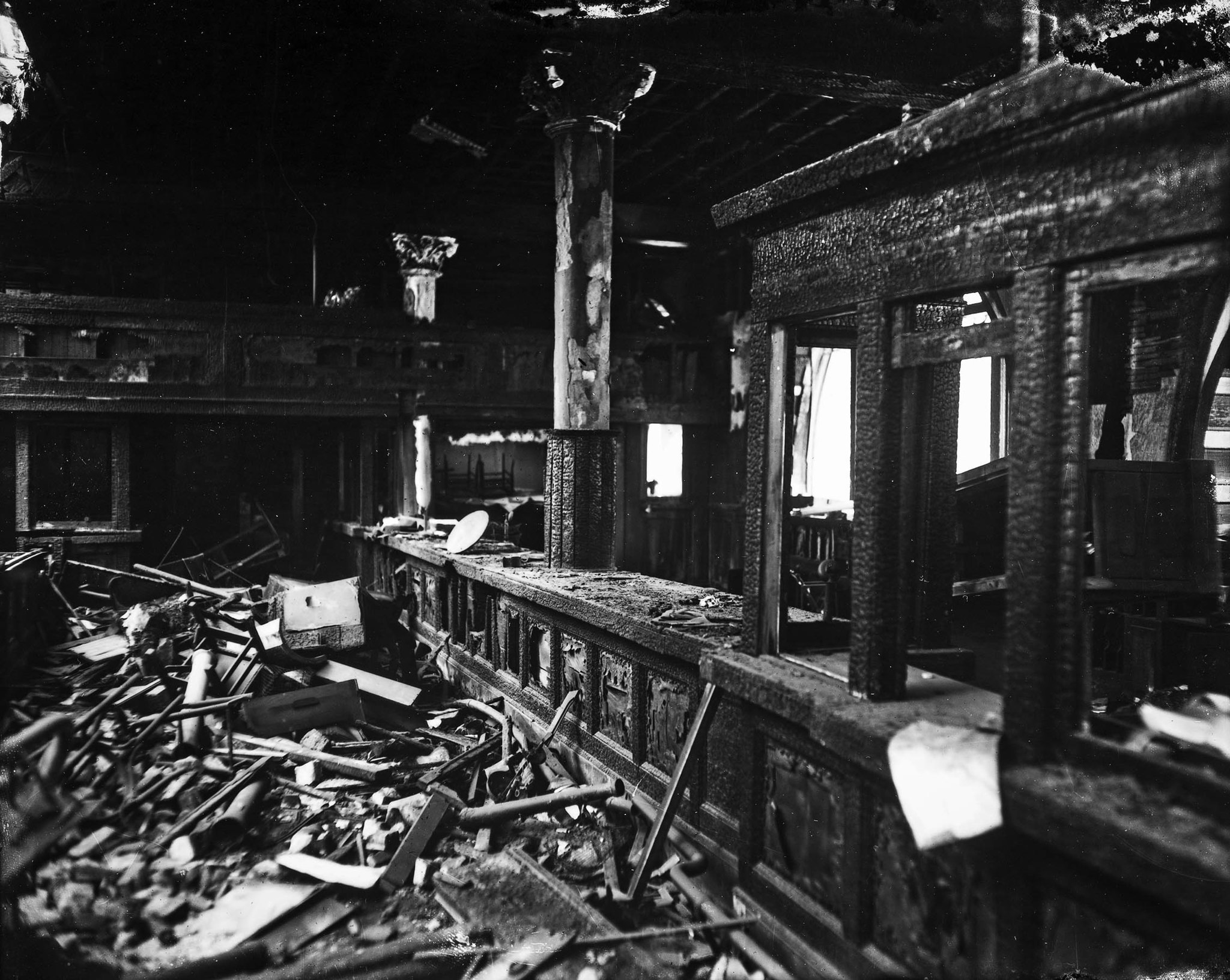 Oct. 1910: The burned remains of the main business counter, which used wood from dozens of sources,