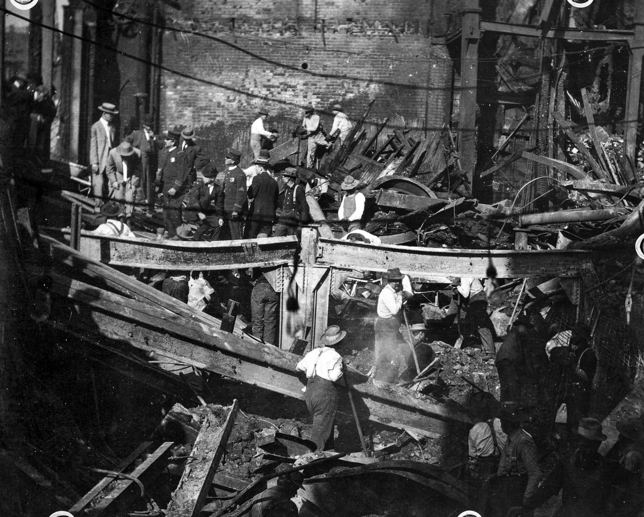 Oct. 1920: Police officials tour the ruins of the Los Angeles Times after the Oct. 1, 1910, bombing.