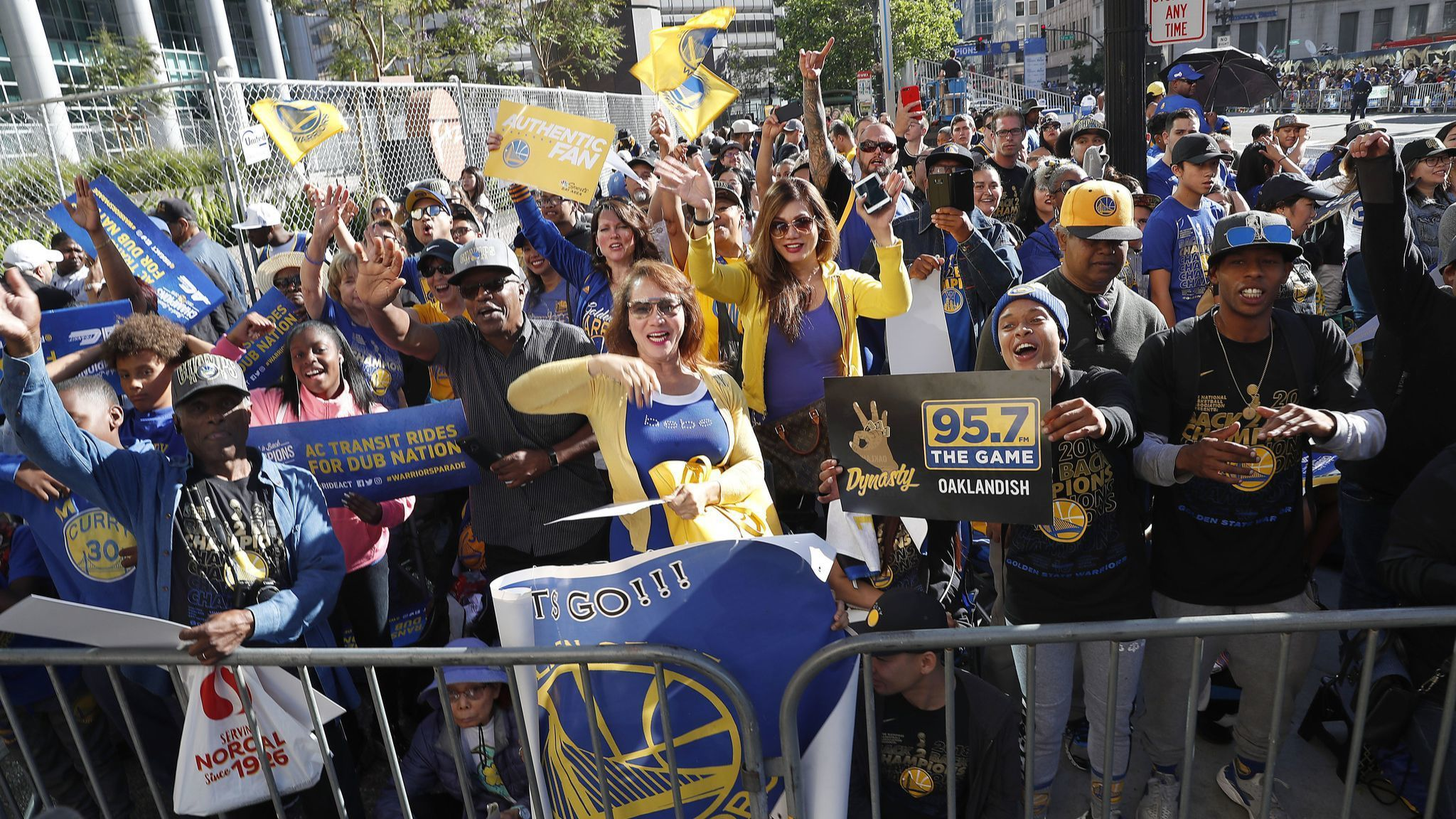 Fans wait for the parade to start in honor of the Golden State Warriors, Tuesday, June 12, 2018, in