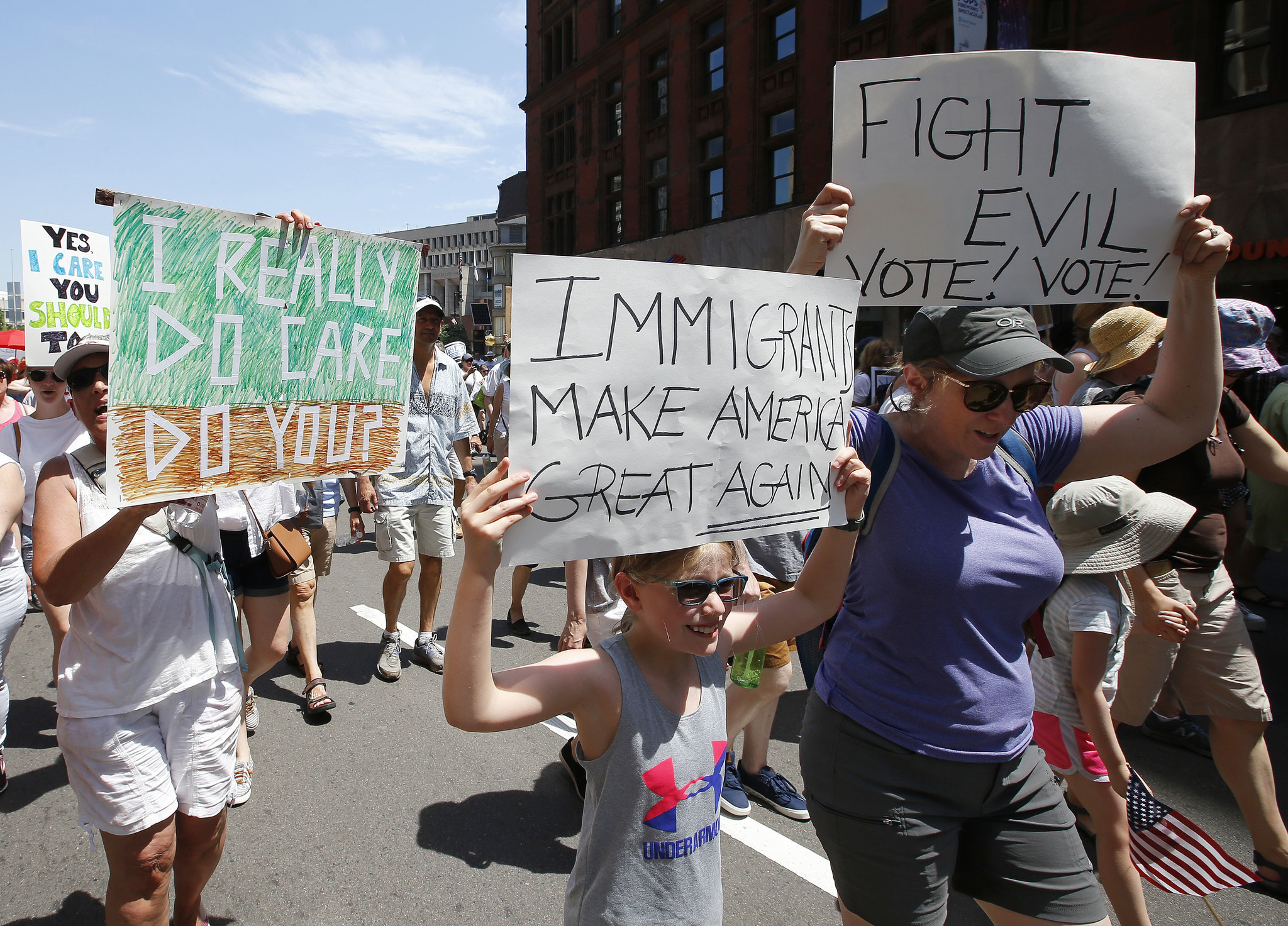 Sara Karp, center, of Acton, Mass., marches in a Rally Against Separation Saturday, June 30, 2018, i