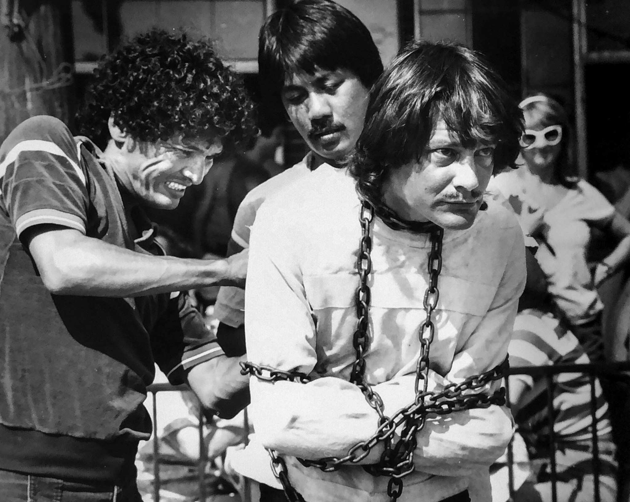July 1984: Escape artist Tim Eric is placed in chains and straitjacket at Venice Beach. He escaped