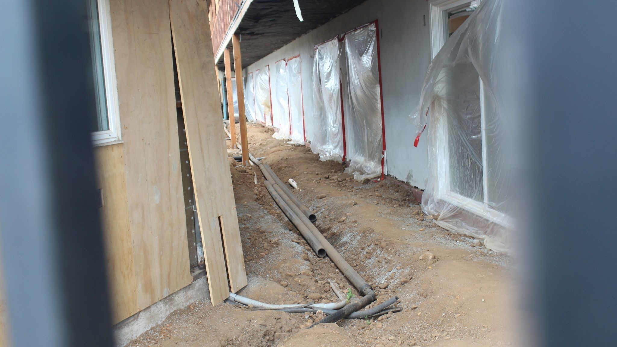 The remaining work includes installing a new sewer line.