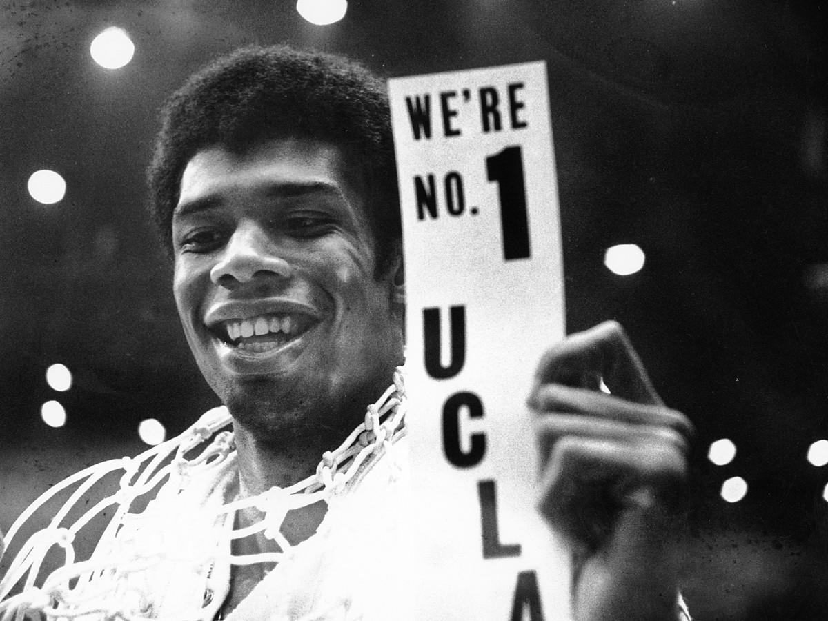 UCLA's Lew Alcindor celebrates after leading the Bruins to the NCAA men's basketball championship on March 23, 1968