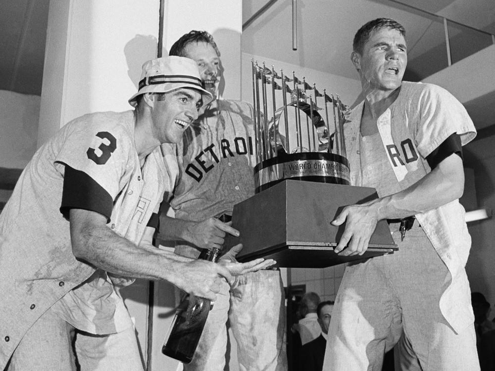 Dick McAuliffe, Jim Northrup and Mickey Stanley celebrate with the Commissioner's Trophy on Oct. 10, 1968, after the Detroit Tigers defeated the St. Louis Cardinals, 4-1, to win the World Series.