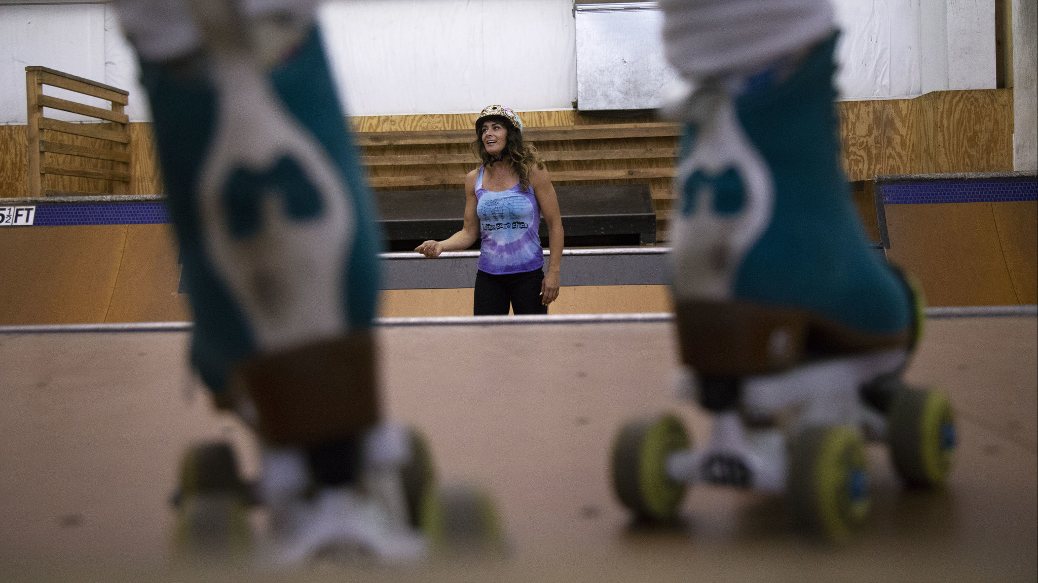 Michelle Steilen instructs students during a roller skating workshop at Camp Woodward in Tehachapi.