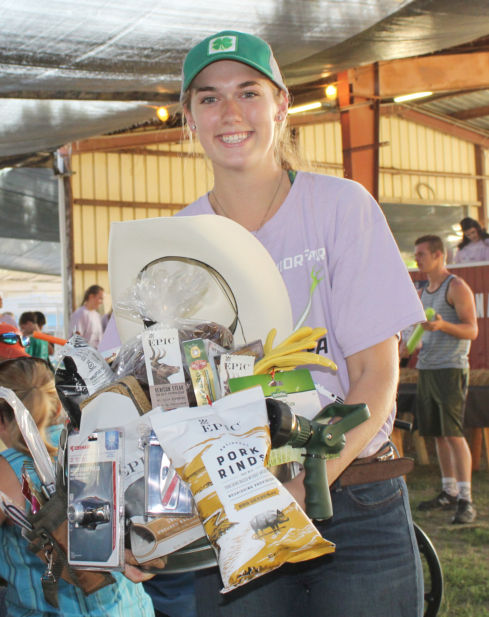 Amanda Donais carries the Ramona Stars 4-H Man Basket that received a high bid of $660.