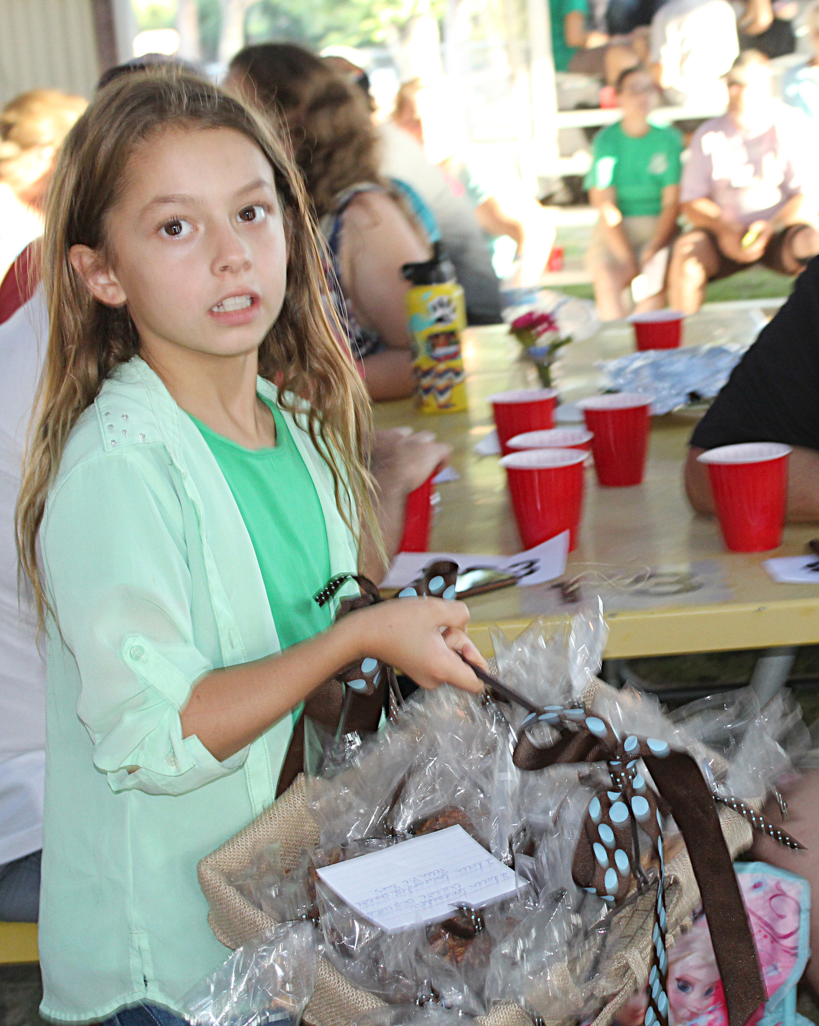 Ramona Stars 4-H'er Payton Scott shows a basket of Ghiradelli Chocolate Chip Cookies and Pecan Pie Bars that Booth Pumps received for $150.