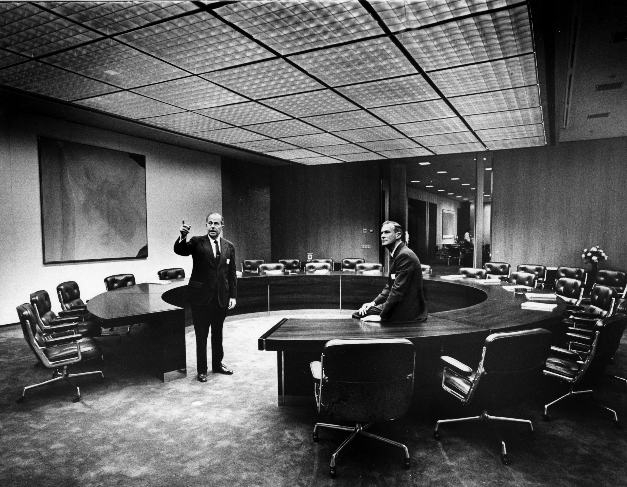 May 22, 1973--(L-R) Dr. Franklin D. Murphy chairman of Times Mirror, shows Dr. Peter S. Bing, a new