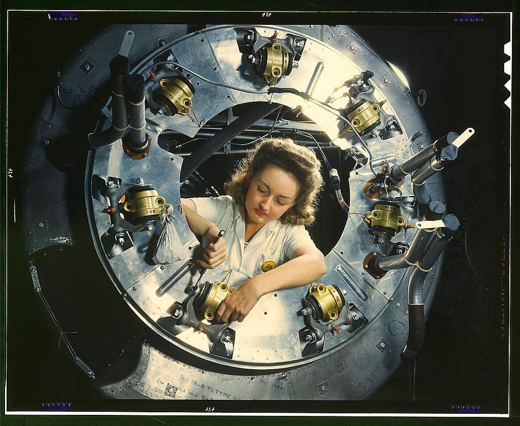 Part of the cowling for one of the motors for a B-25 bomber is assembled in the engine department of