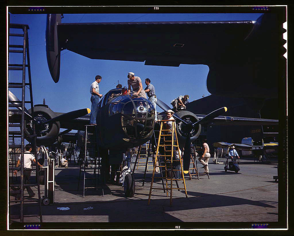 On North American's outdoor assembly line, employees rush a B-25 to completion, North American Aviat