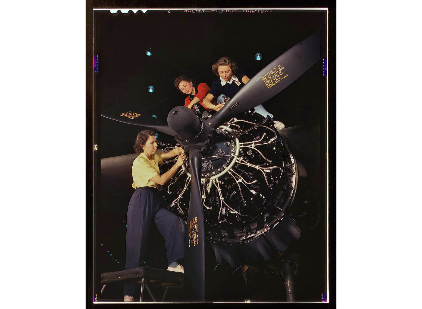 Female workers trained in precise aircraft engine installation duties at Douglas Aircraft Company, Lo