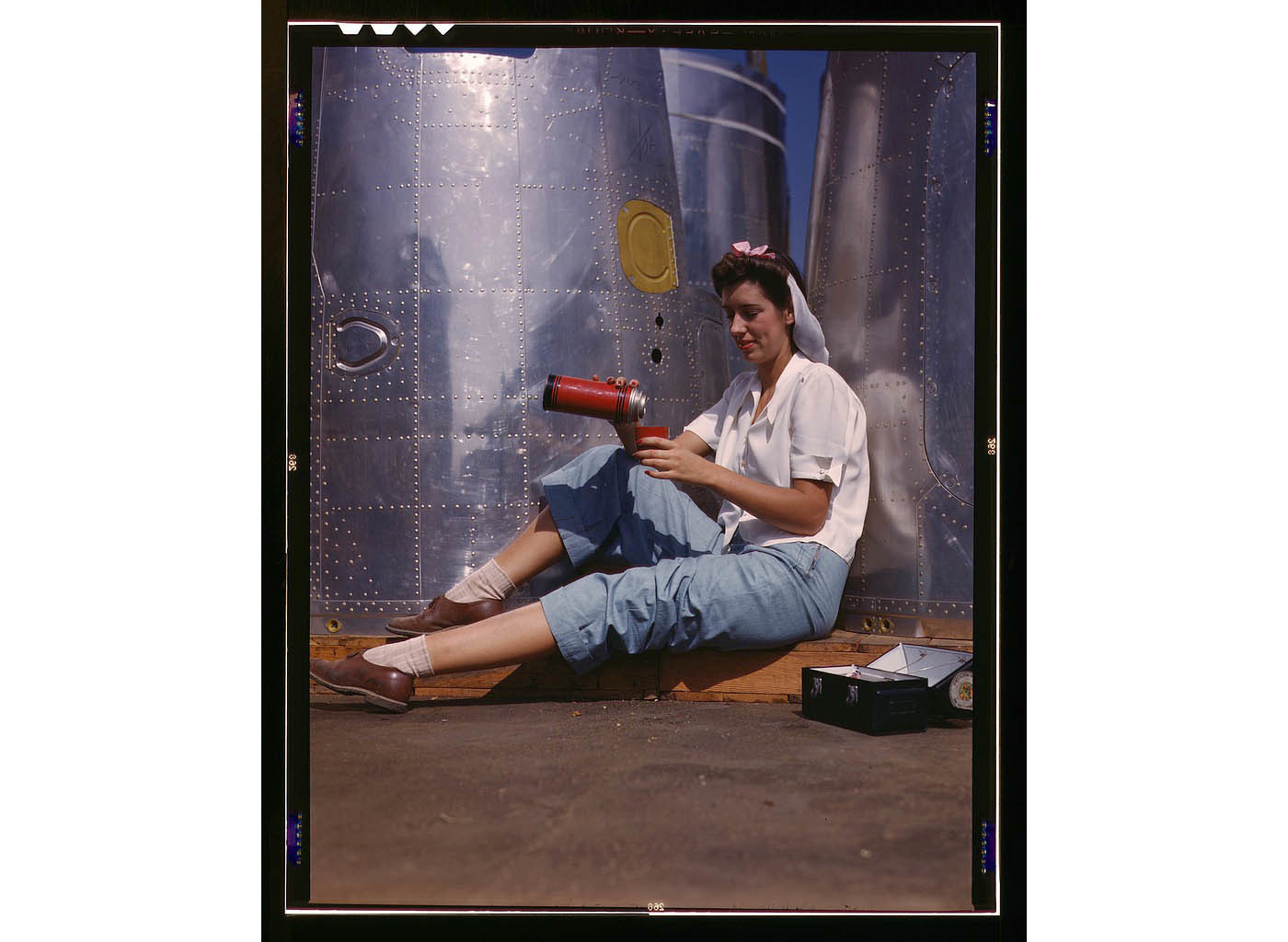 Girl worker at lunch also absorbing California sunshine, Douglas Aircraft Company, Long Beach, Calif