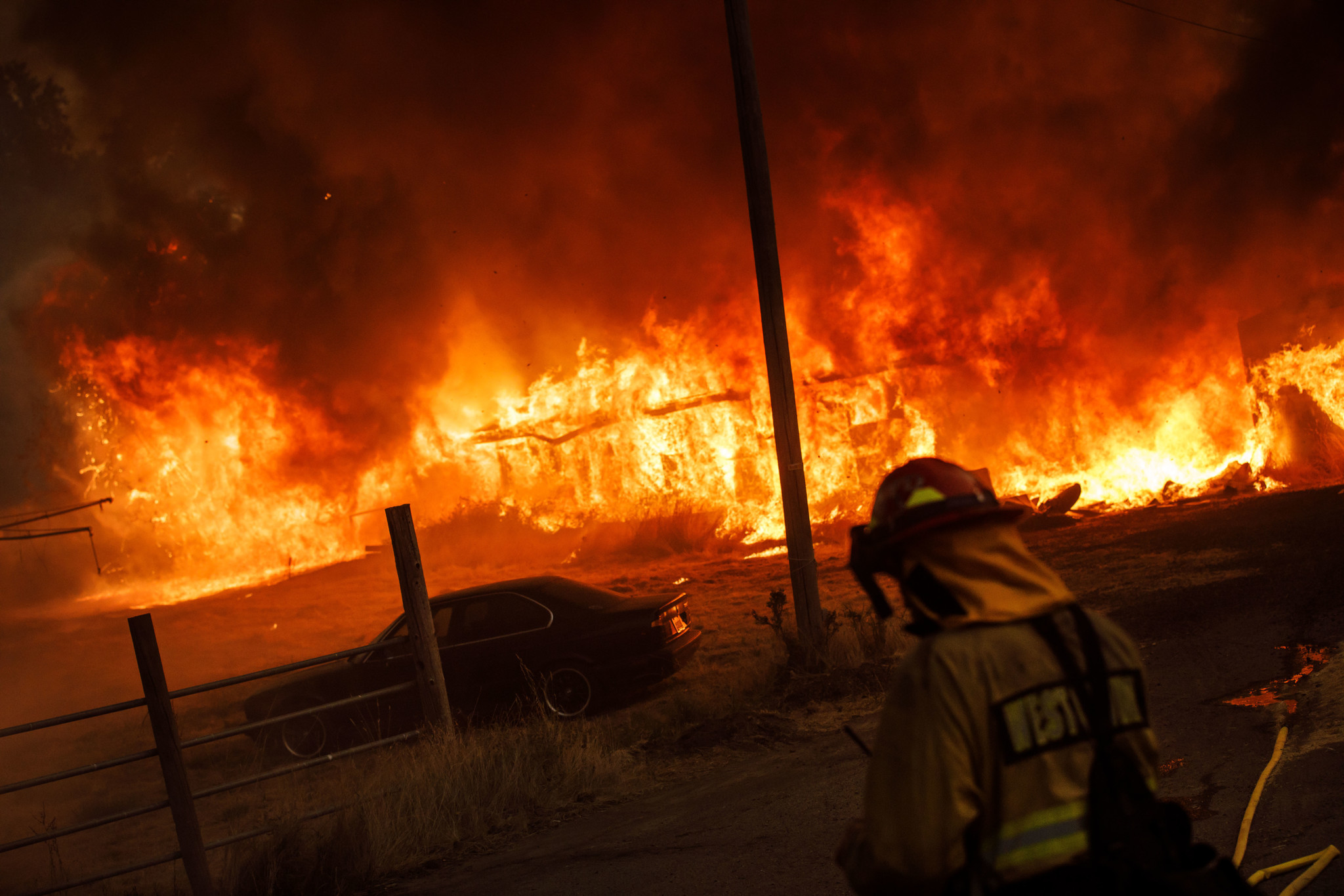 LAKEPORT, CALIF. — TUESDAY, JULY 31, 2018: A barn is engulfed in flames as the River Fire spreads w