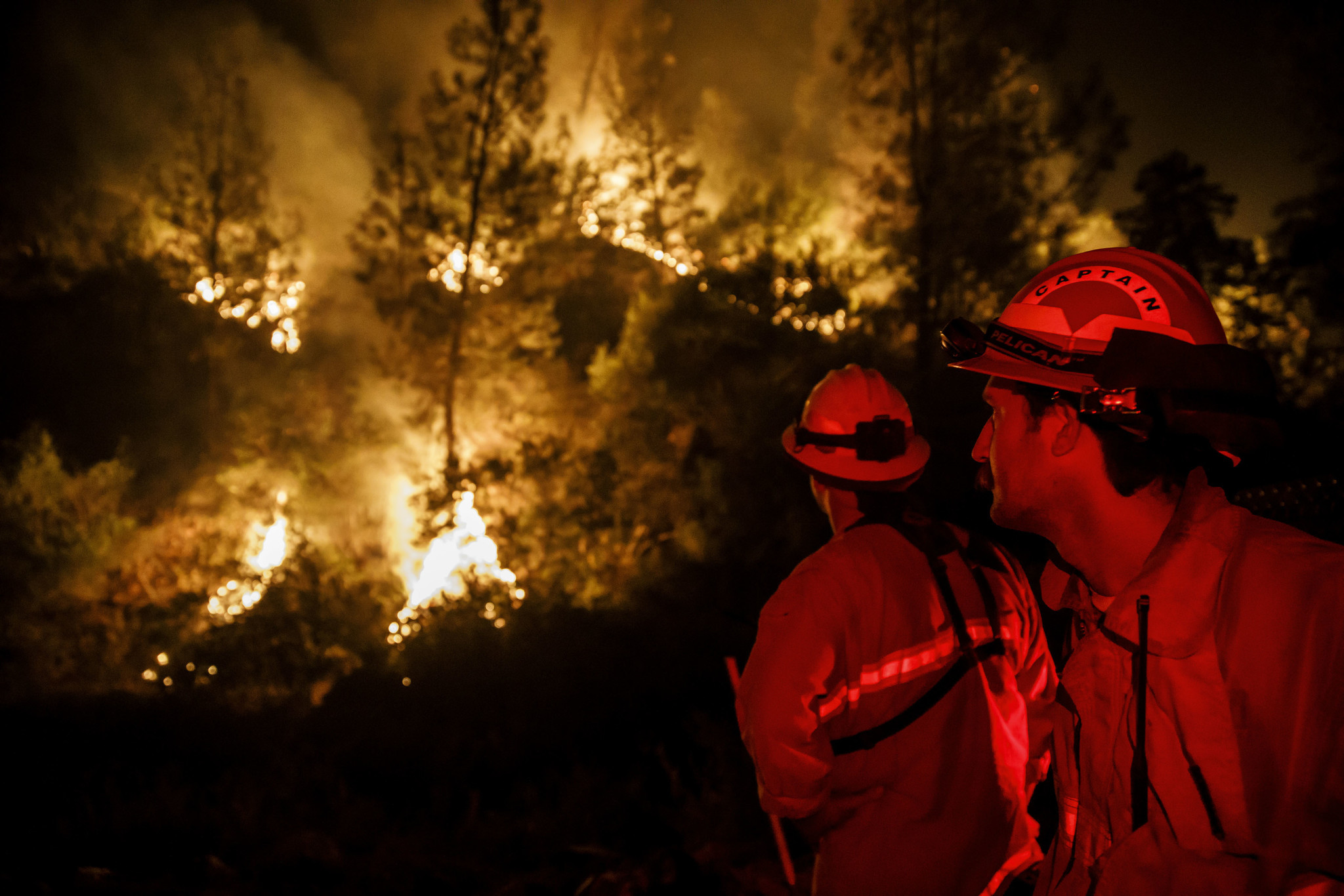 LADOGA, CALIF. — TUESDAY, AUGUST 7, 2018: Firefighters monitor a burn operation near Ladoga, Calif.
