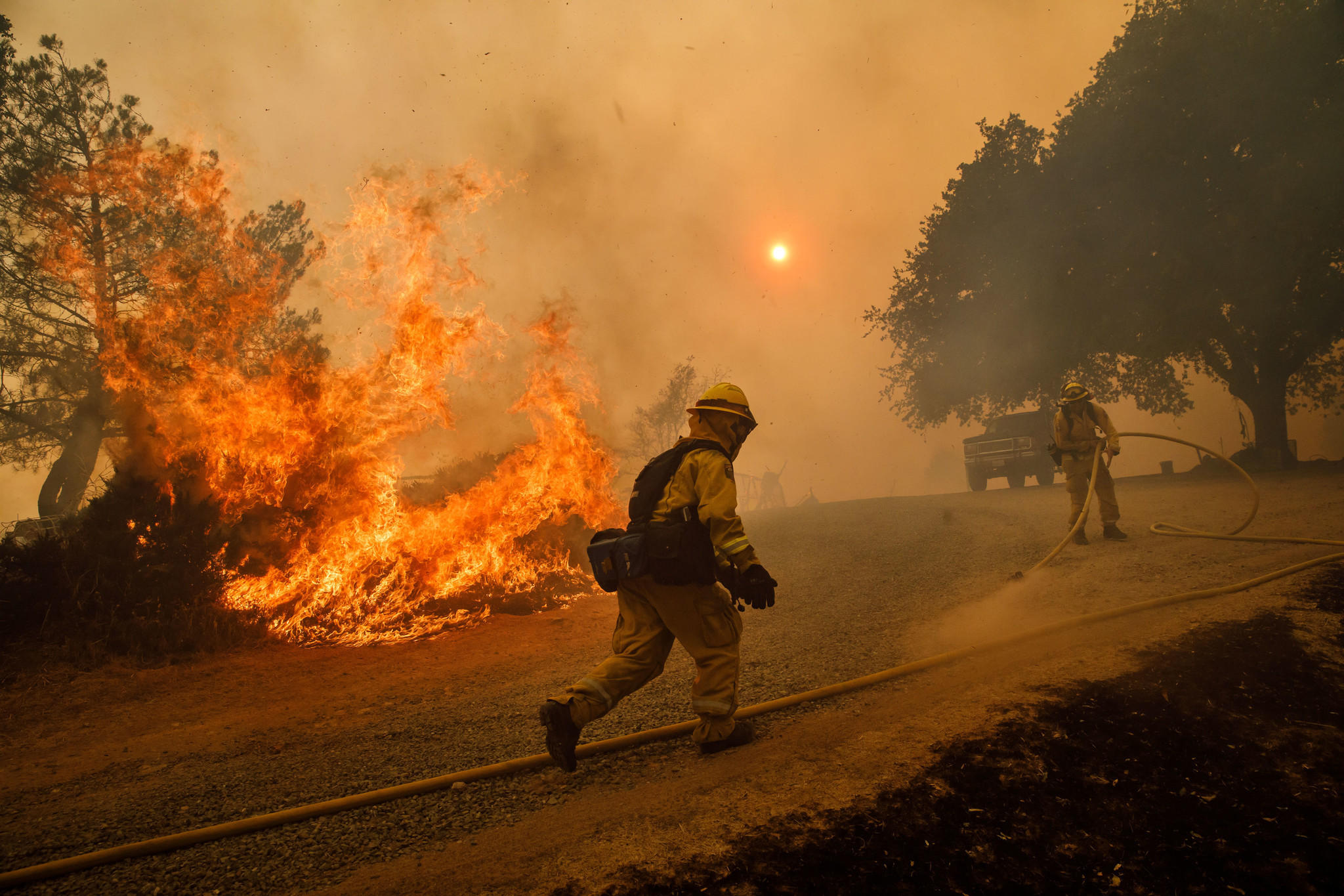 LAKEPORT, CALIF. — TUESDAY, JULY 31, 2018: Firefighters work to keep flames from the River Fire fro
