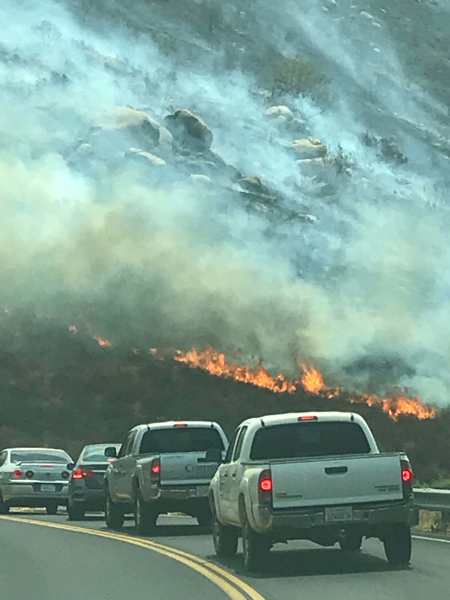 Ramona resident Kimberly Warnock captures this photo of the Rangeland fire just before she turned around on SR-78 east of San Pasqual Academy.