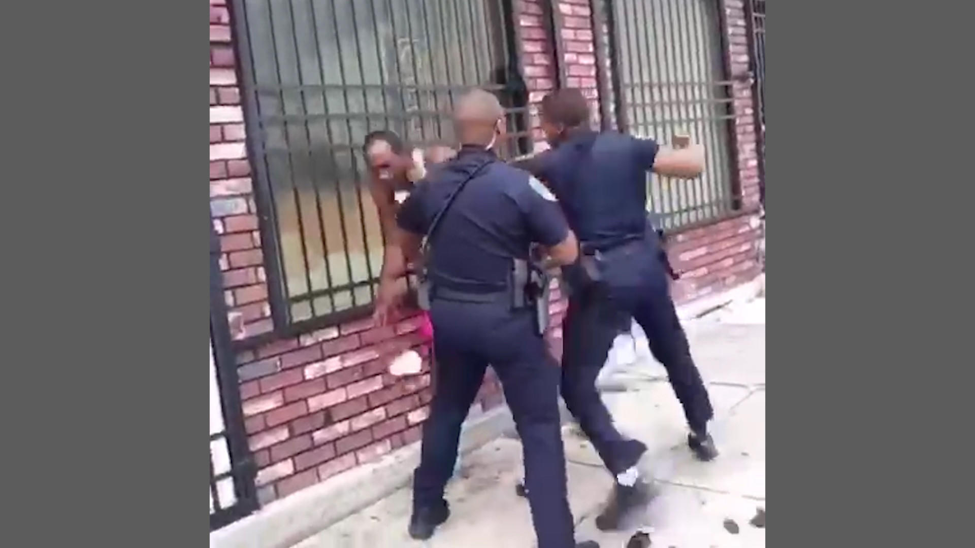 Baltimore police officer who was shown on video beating man is charged with  assault and turns himself in