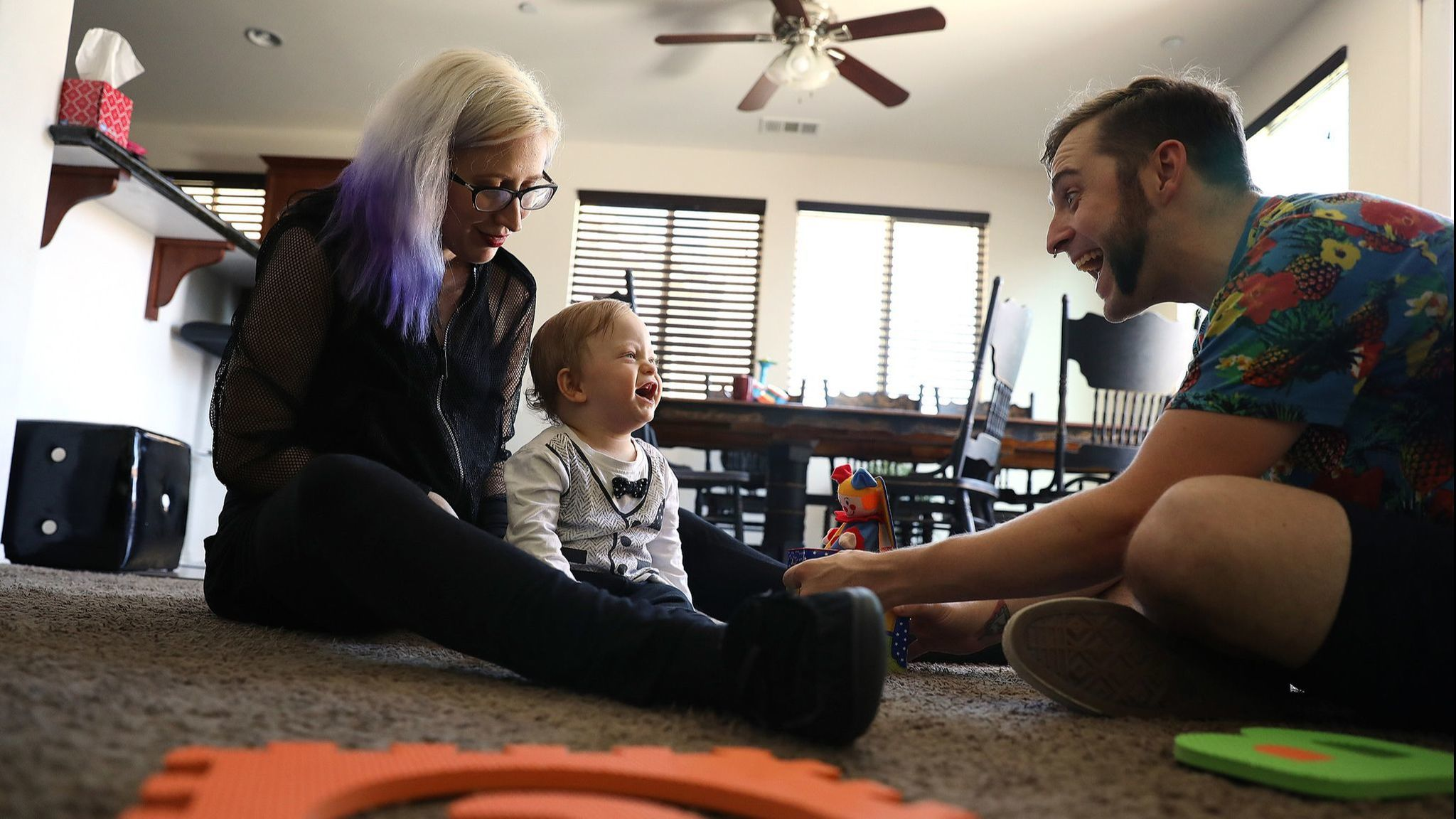First-time homebuyers James Cunningham and Heather Mathiesen play with their son, Hugo, at home in Lancaster. (Christina House / Los Angeles Times)