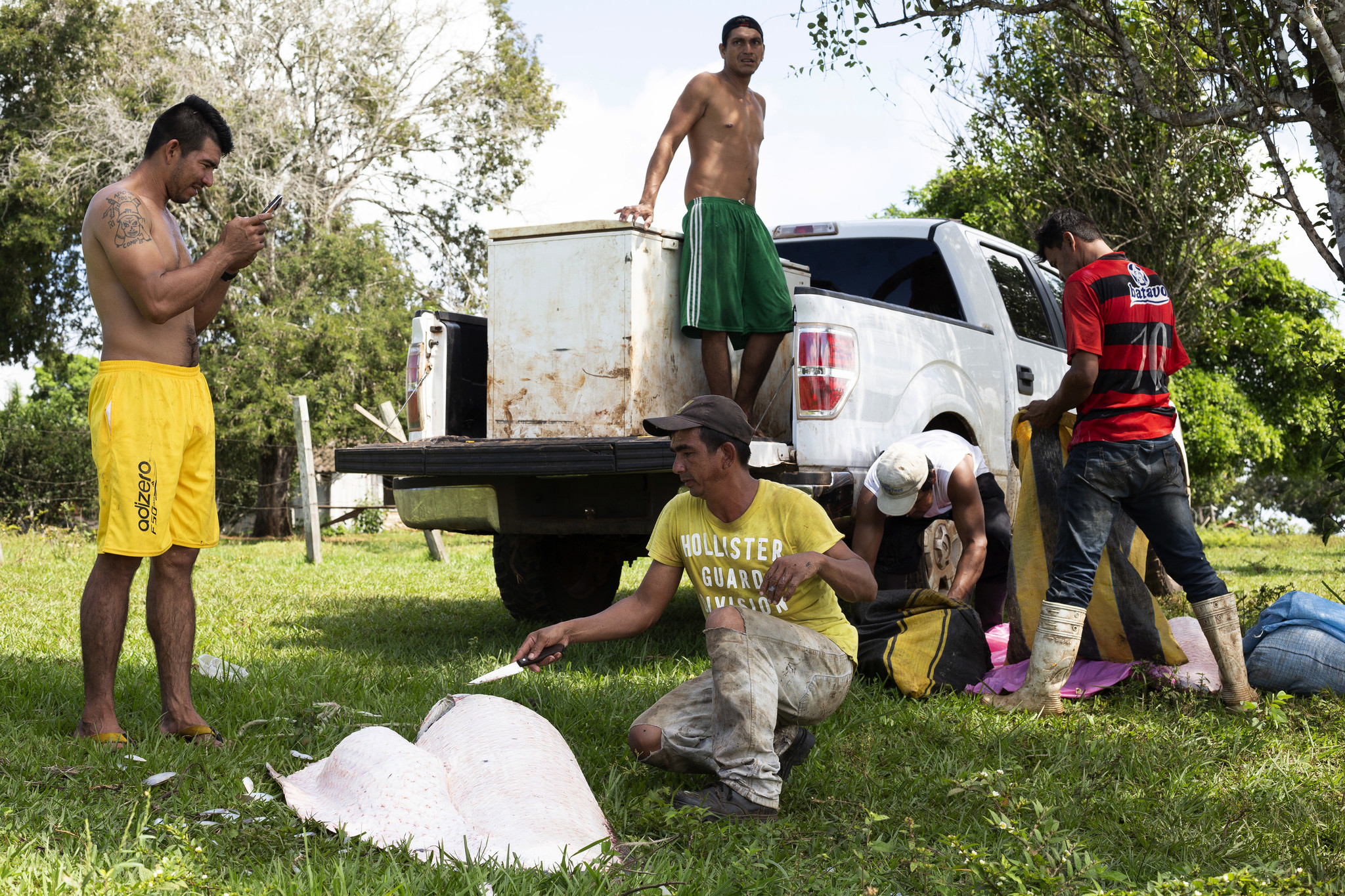 Samuel Surubí, left, supervises his fishing operation in the town of San Lorenzo. Native species hav