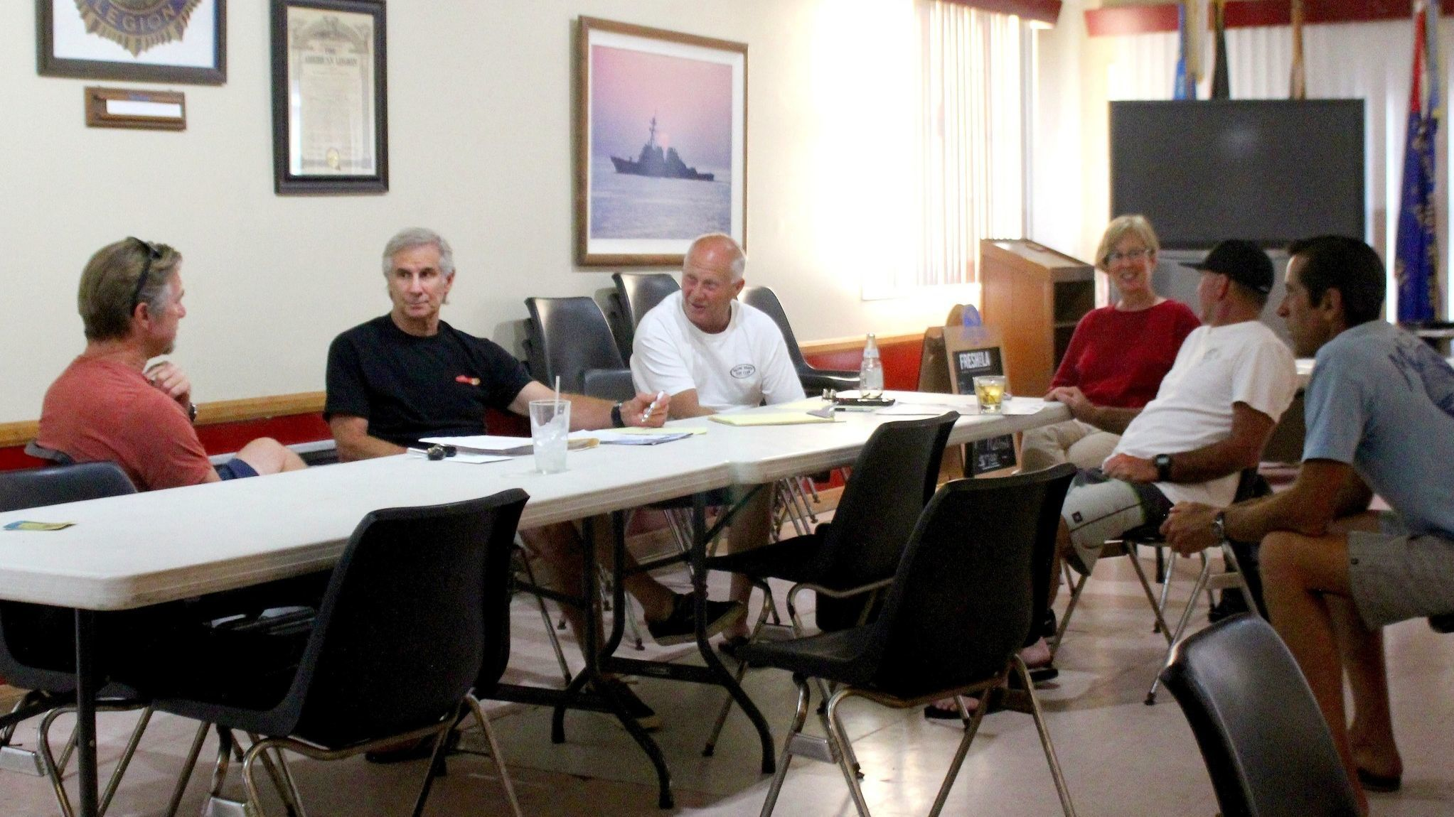 Chris Volk, Ron Greene, Bob Peacock, Teresa Burdick, Dan Dodd and Vince Bodie hold a recent Pacific Beach Surf Club meeting at VFW Post 5985 on Turquoise Street.