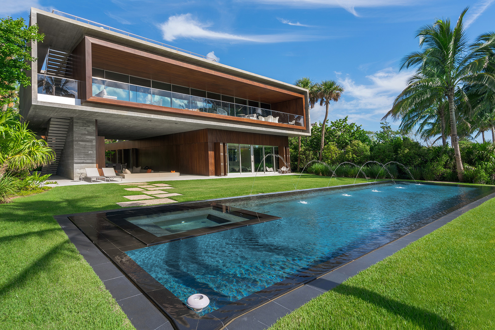 Miami Beach Mansion With Private Lagoon Basketball Half Court Winding Bridge Goes For Almost 26 Million Sun Sentinel