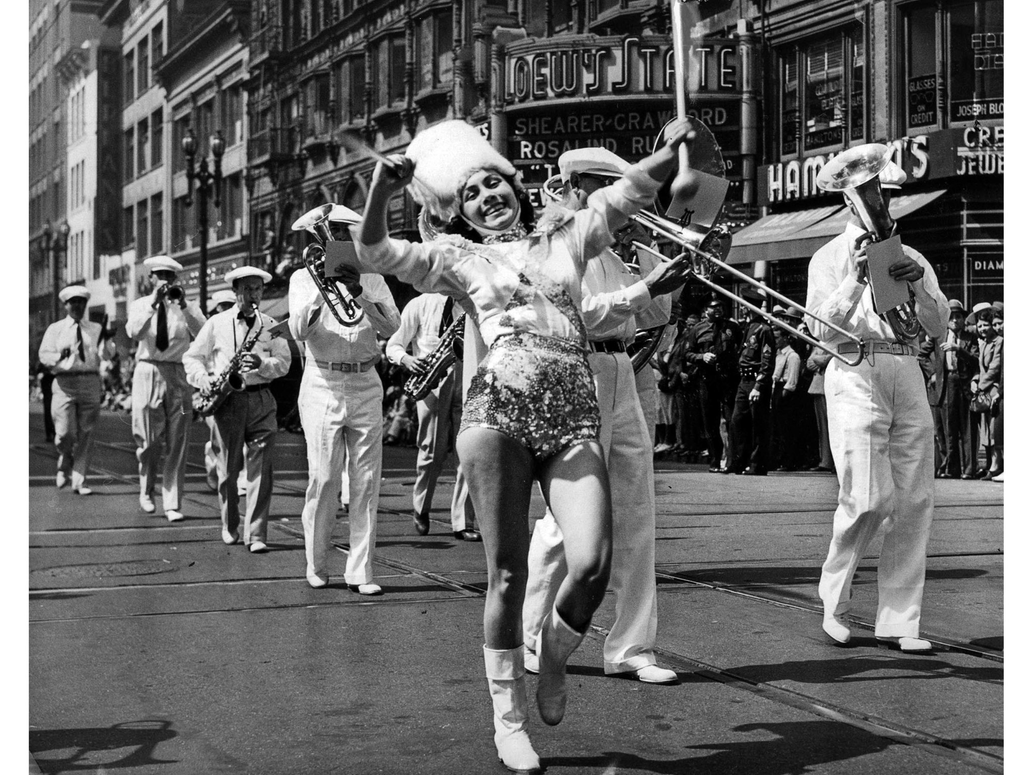 Sept. 4, 1939: Majorette leads band at Seventh and Broadway during annual Labor Day parade.