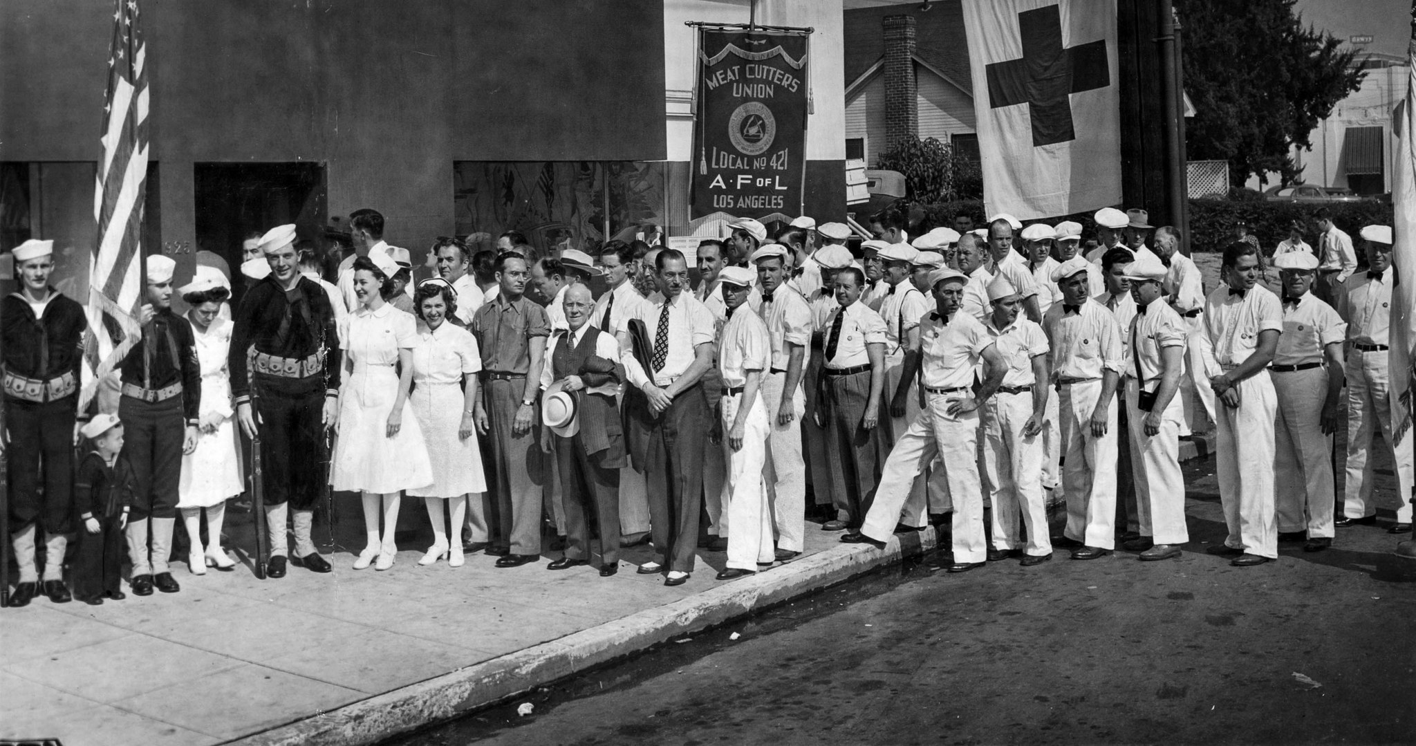 Sep. 7, 942: Members of the Meat Cutters Union, Local No. 421, line up at the door of Blood Bank dur