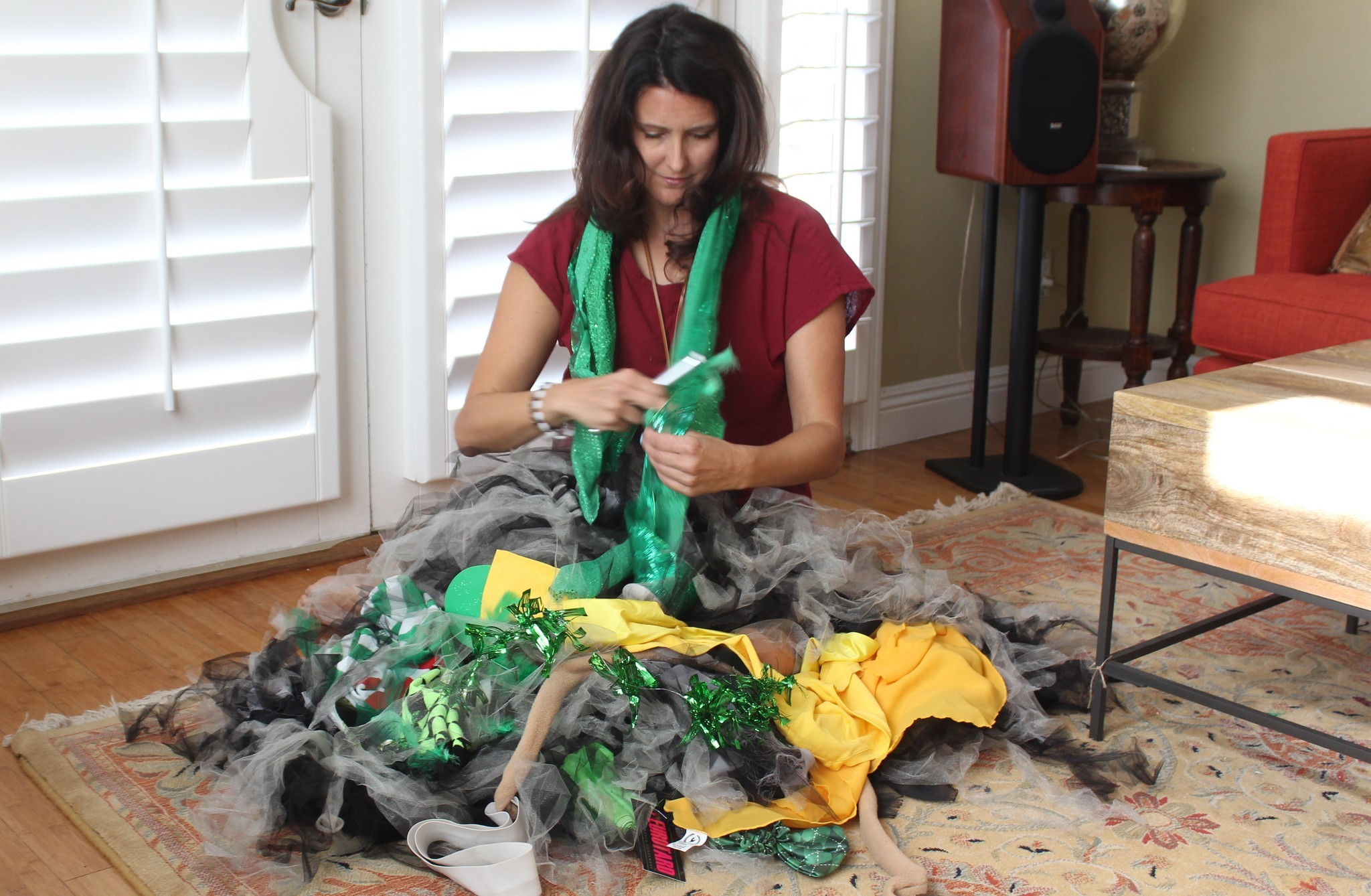 In her WindanSea living room, Shusterman packs the costumes she will bring on her groundbreaking trip to Africa.