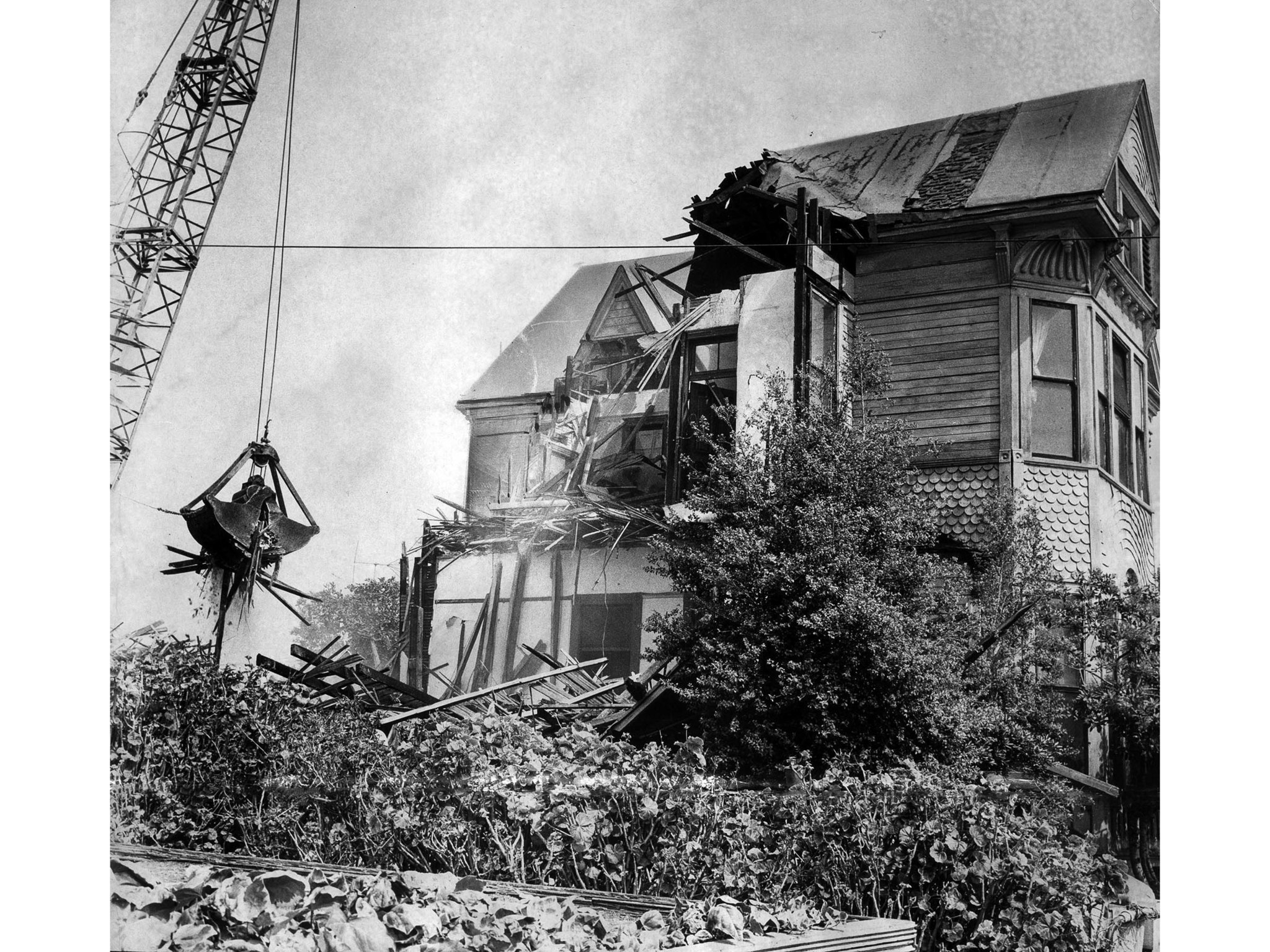 Sep. 10, 1966: A demolition crane takes a bite out of one of the last Victorian structures on Bunker