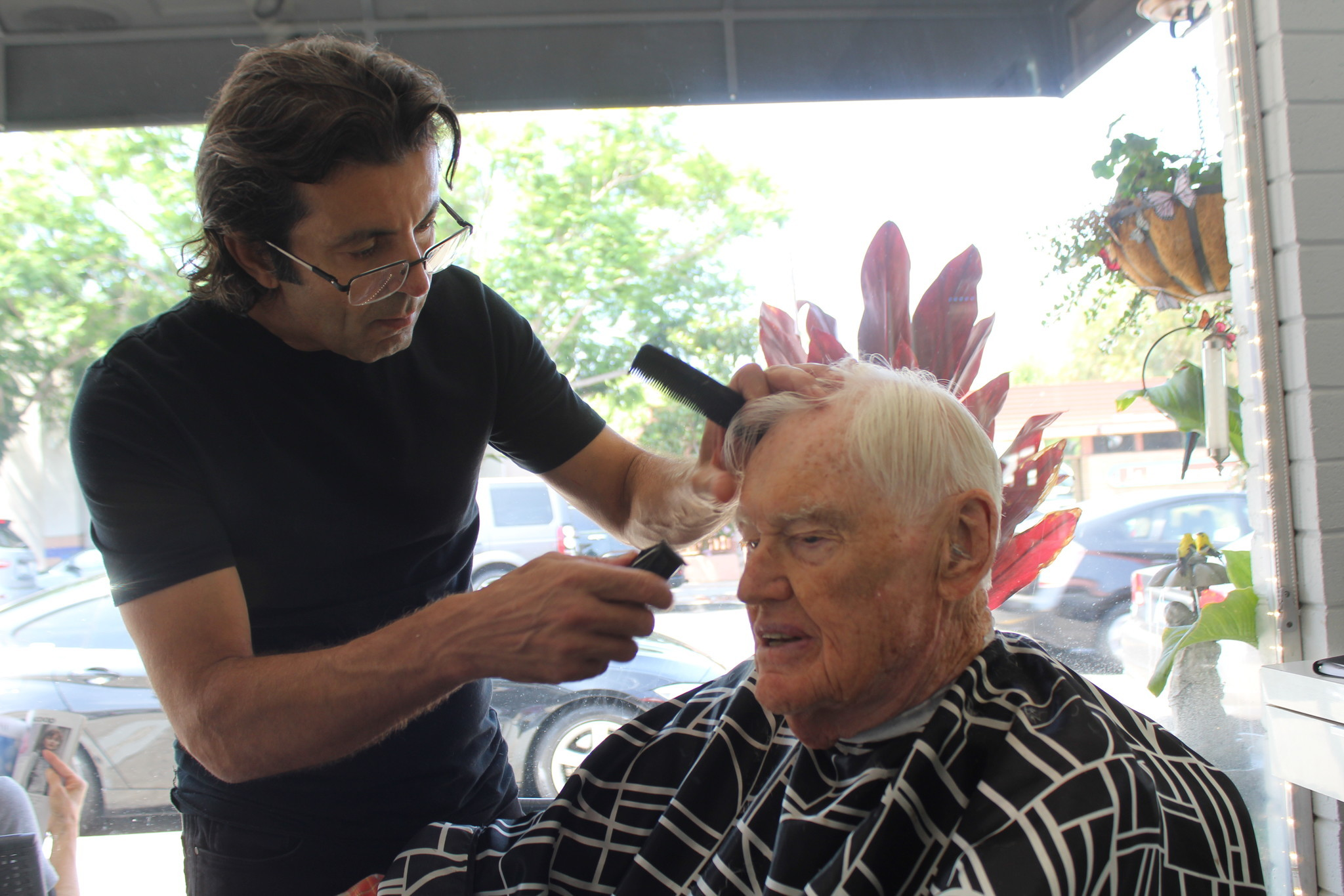 Crosby gets his six-week haircut from Alex Ashirob, owner of Alex Salon.