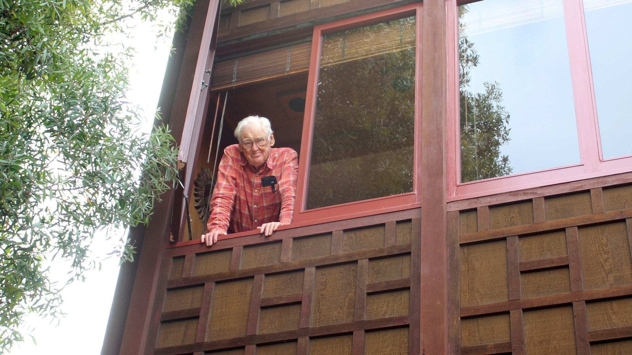 Harry Crosby greats the 'Light' from the window of the La Jolla house he designed and built in 1979.