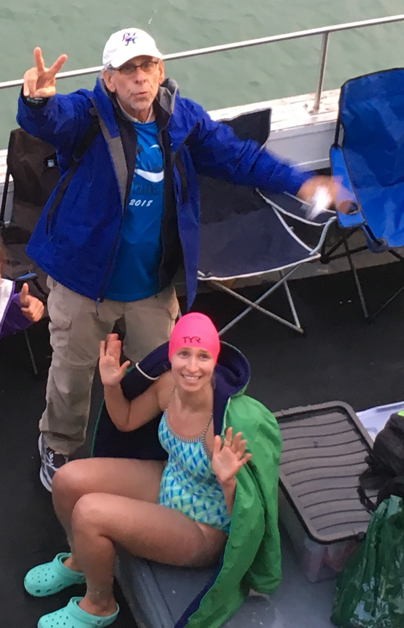 Melanie Kaplan and her father, Robert, are shown aboard the support boat before her crossing.