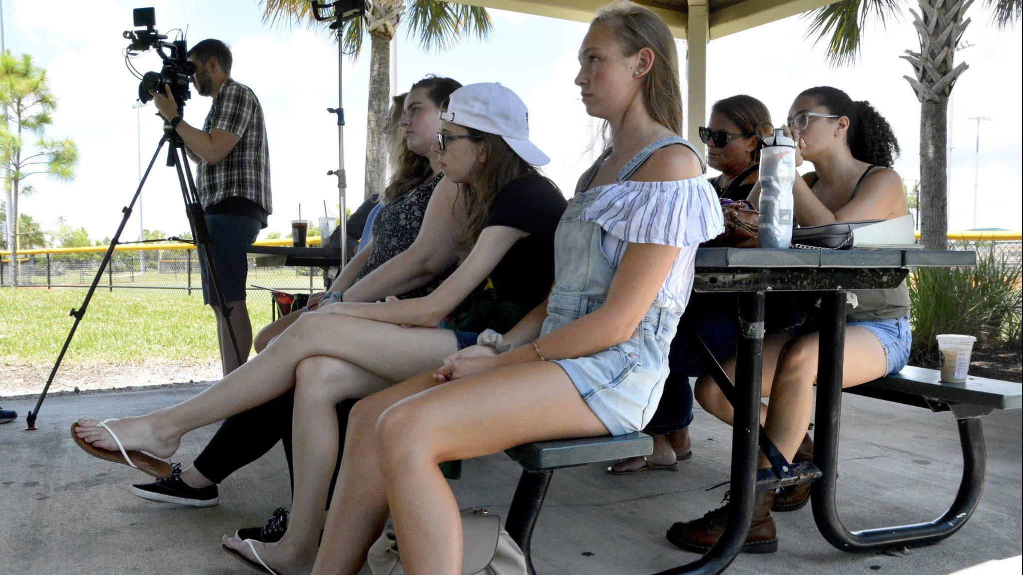 A group of students and a teacher from Great Mills High School in St. Mary's County watch a Marjory