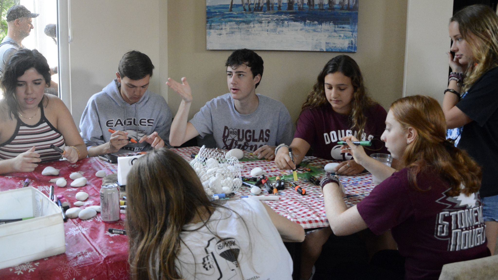 Marjory Stoneman Douglas students paint rocks to exchange with Great Mills students.