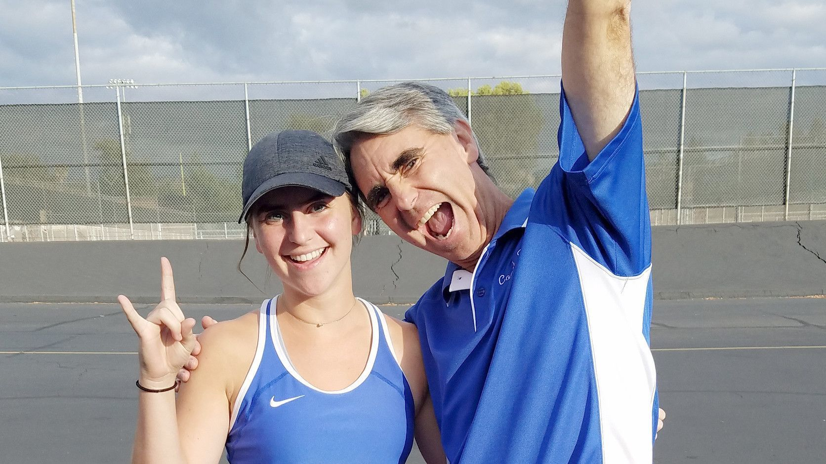 Halli Romero and her coach/father Troy celebrate a victory after Halli and her doubles partner Hannah Nowakowski placed second in a Valley League tournament.
