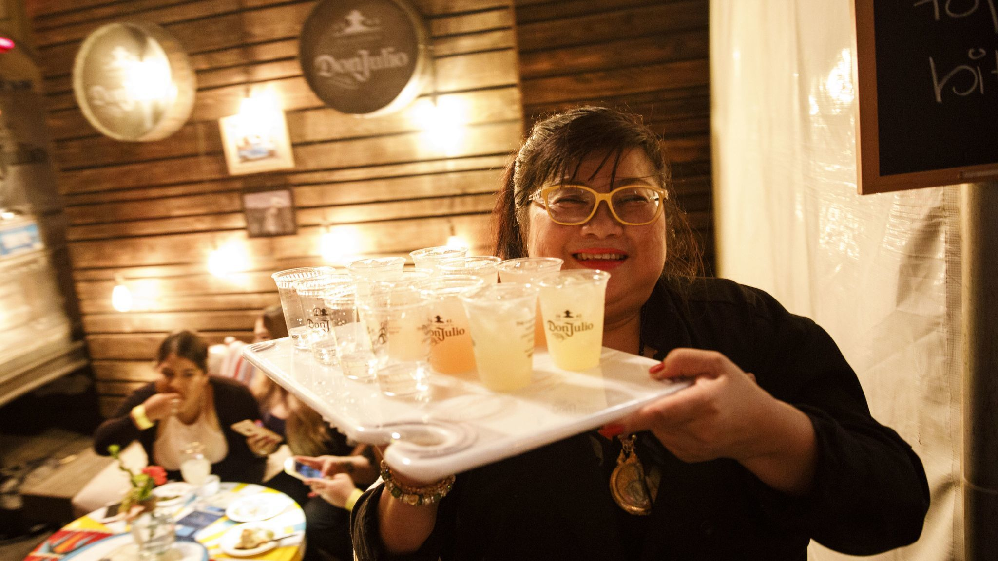 Jazz Singsanong of Jitlada carries away some beverages during The Taste on the Paramount Studios bac