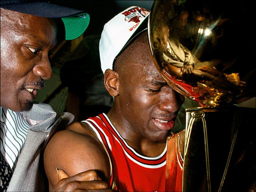 Michael Jordan (23) of the Chicago Bulls celebrates with his father James Jordan