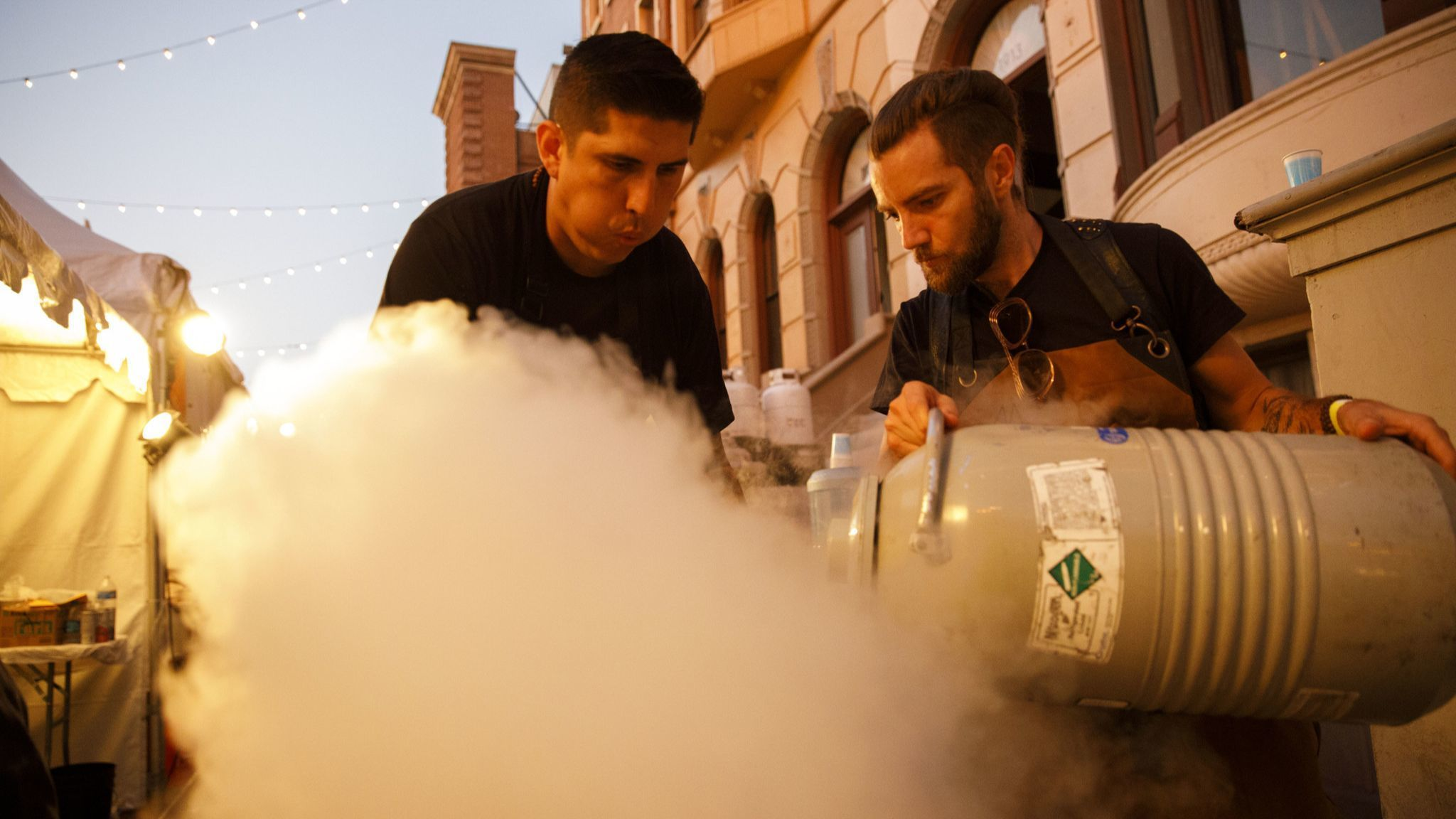 Marcel Vigneron, Wolf chef and owner, right, pours liquid nitrogen with Ramon Bojorquez as they prep