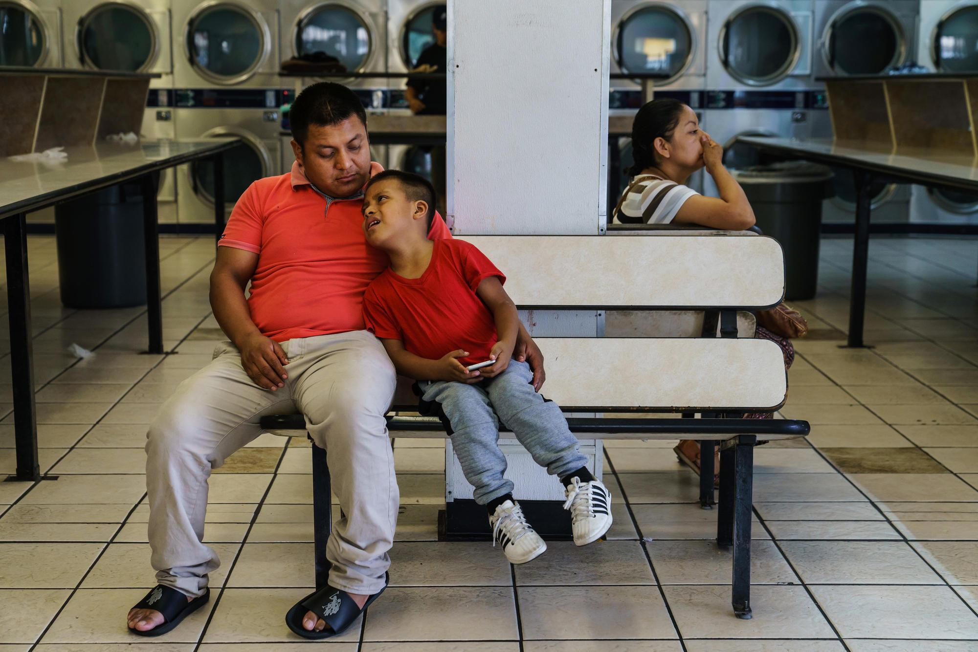 Guatemalan asylum seeker and his son