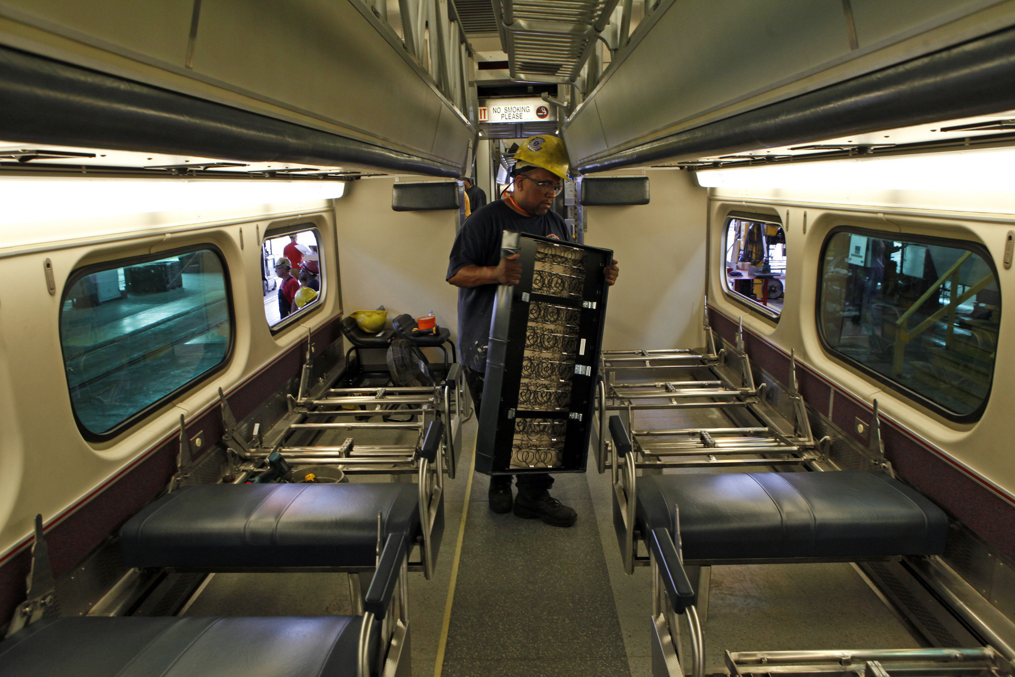 Metra refitting cars with power outlets, new toilets ...