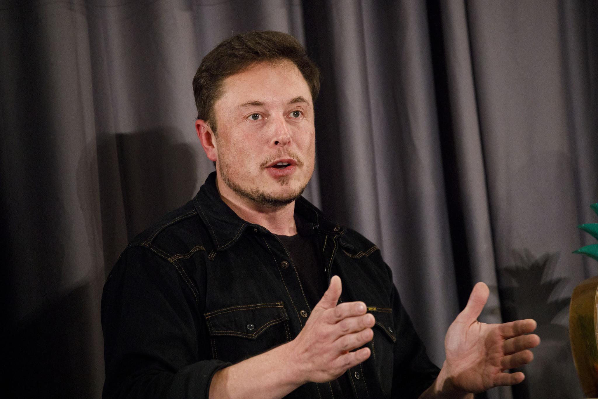 Tesla Stock Falls After Elon Musk Appears To Smoke
