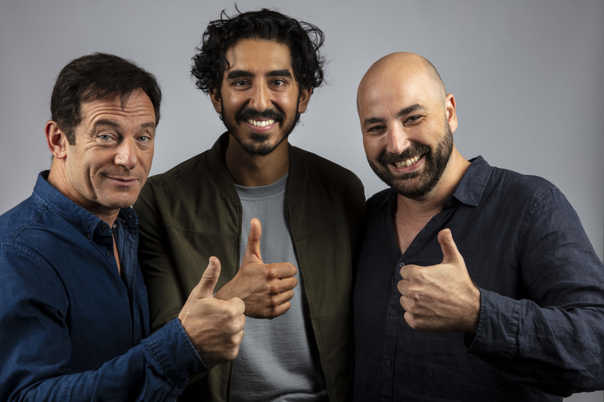 TORONTO, ONT. — SEPTEMBER 07, 2018-- Actor Jason Isaacs, actor Dev Patel, and director Anthony Mar
