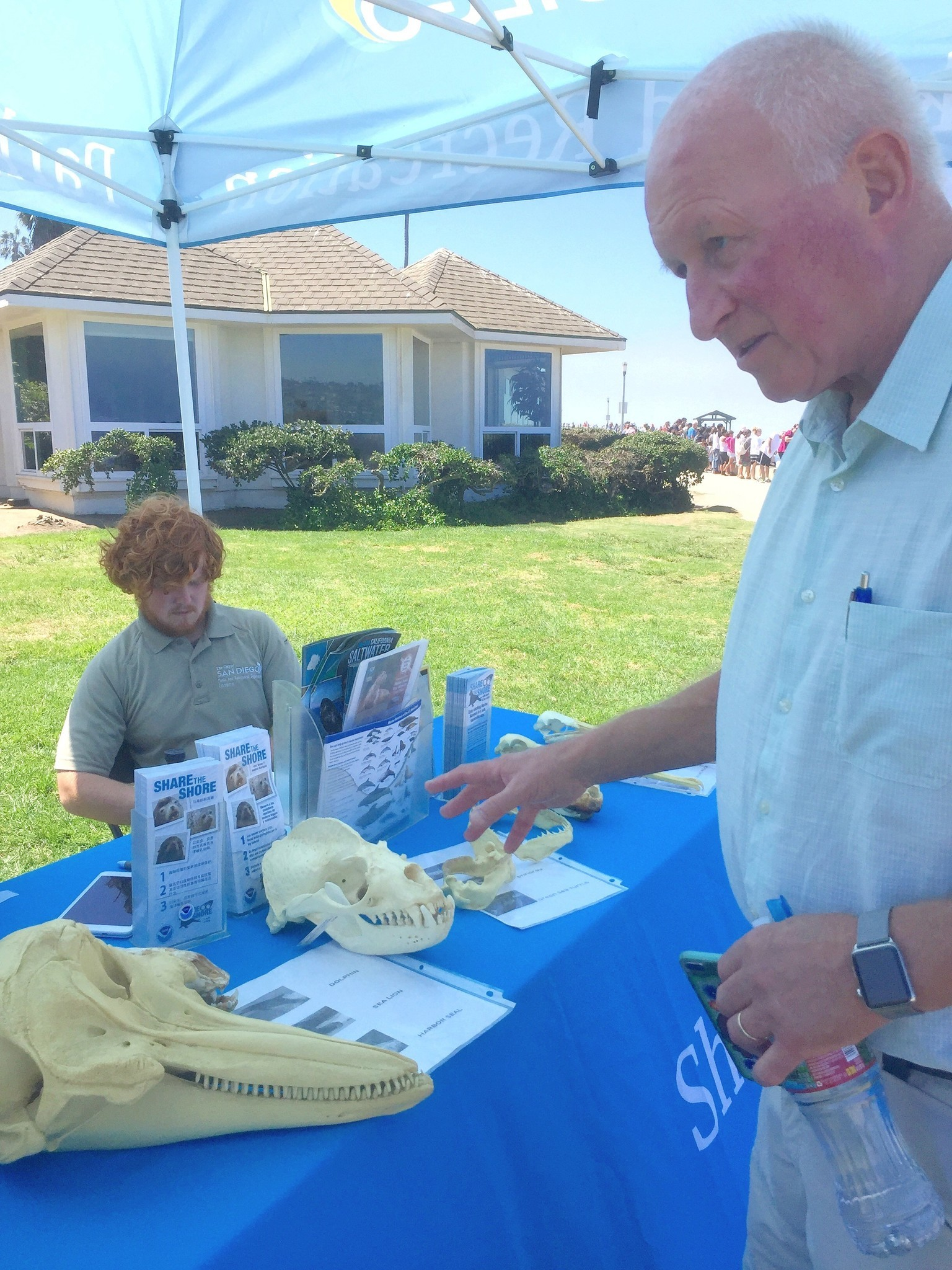 Mugford delivers a lesson in seal biology to interns at a Park & Rec education tent.