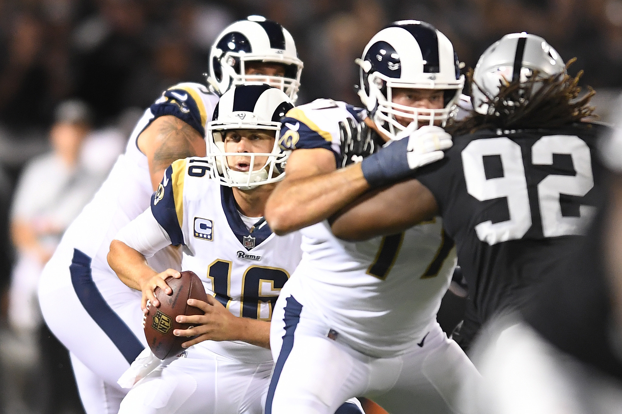 OAKLAND, CALIFORNIA SEPTEMBER 10, 2018-Rams quarterback Jared Goff scrambles against the Raiders at