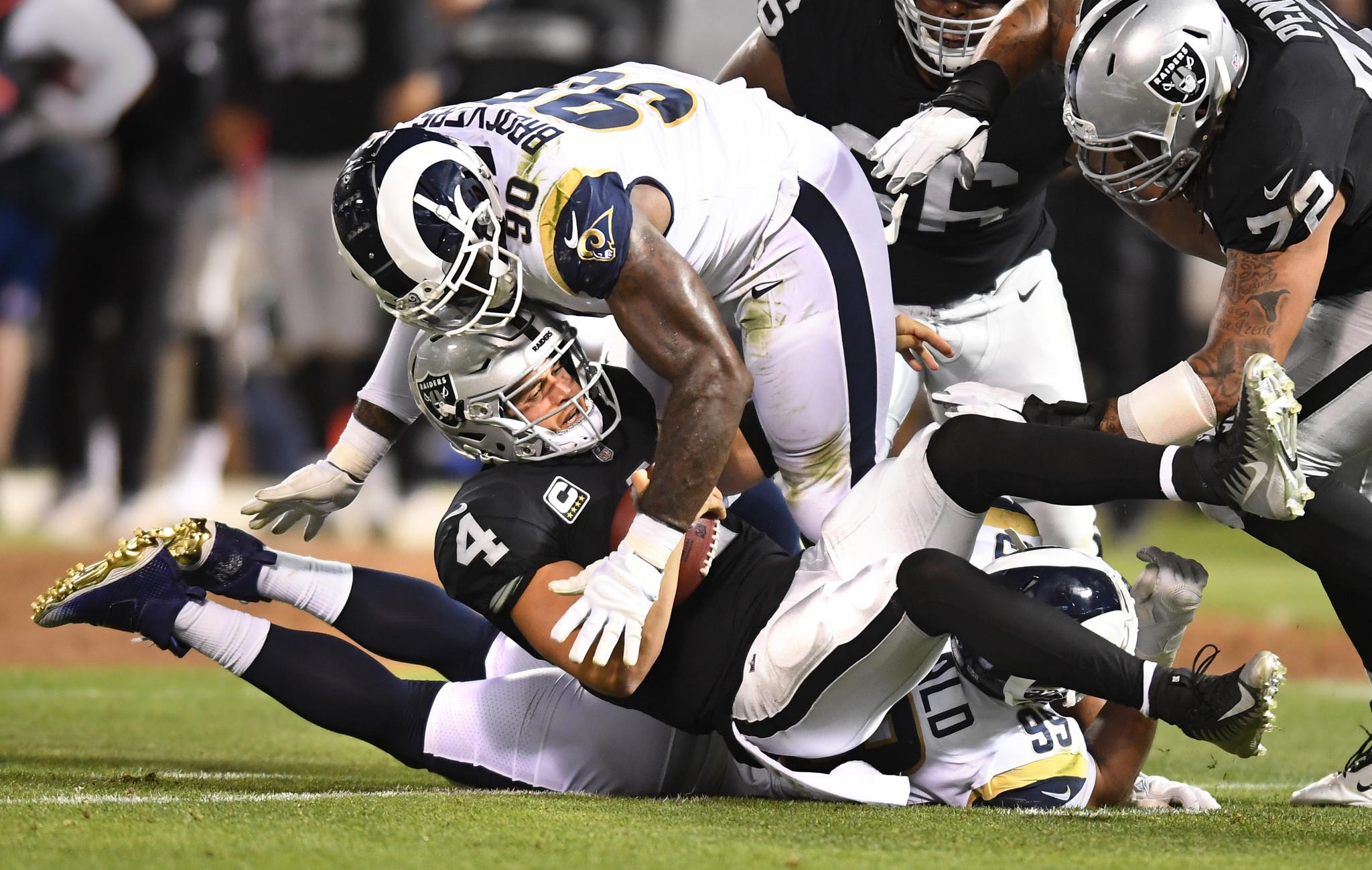 OAKLAND, CALIFORNIA SEPTEMBER 10, 2018-Rams Aaron Donald and Michael Brockers (90) sack Raiders quar