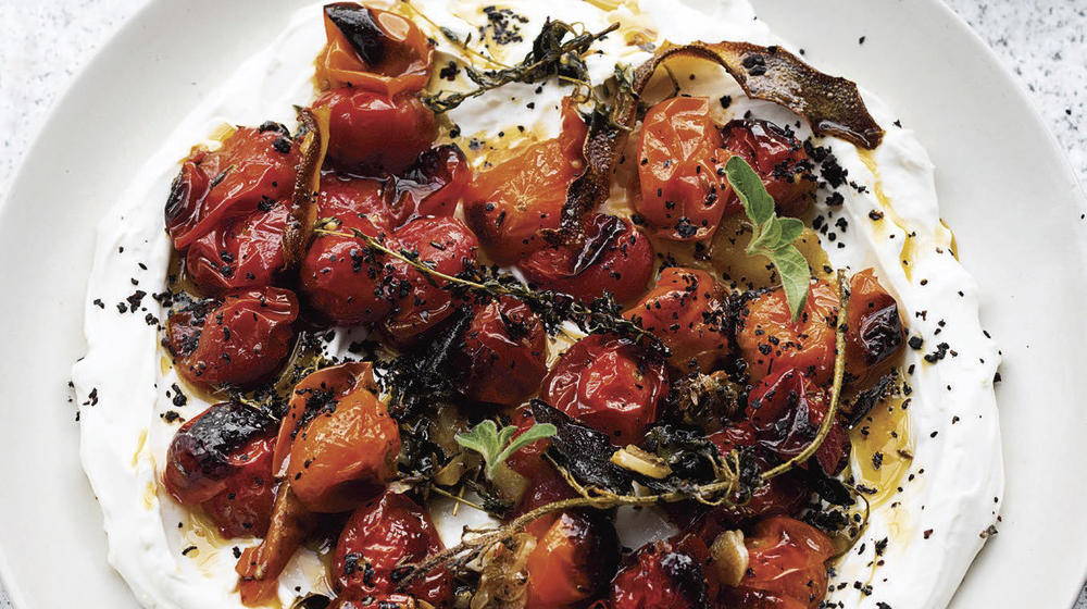 Hot, charred cherry tomatoes with cold yogurt