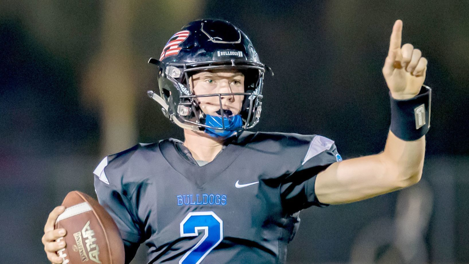 Bulldog quarterback Derek Diamond signals to another player in Friday's home victory.