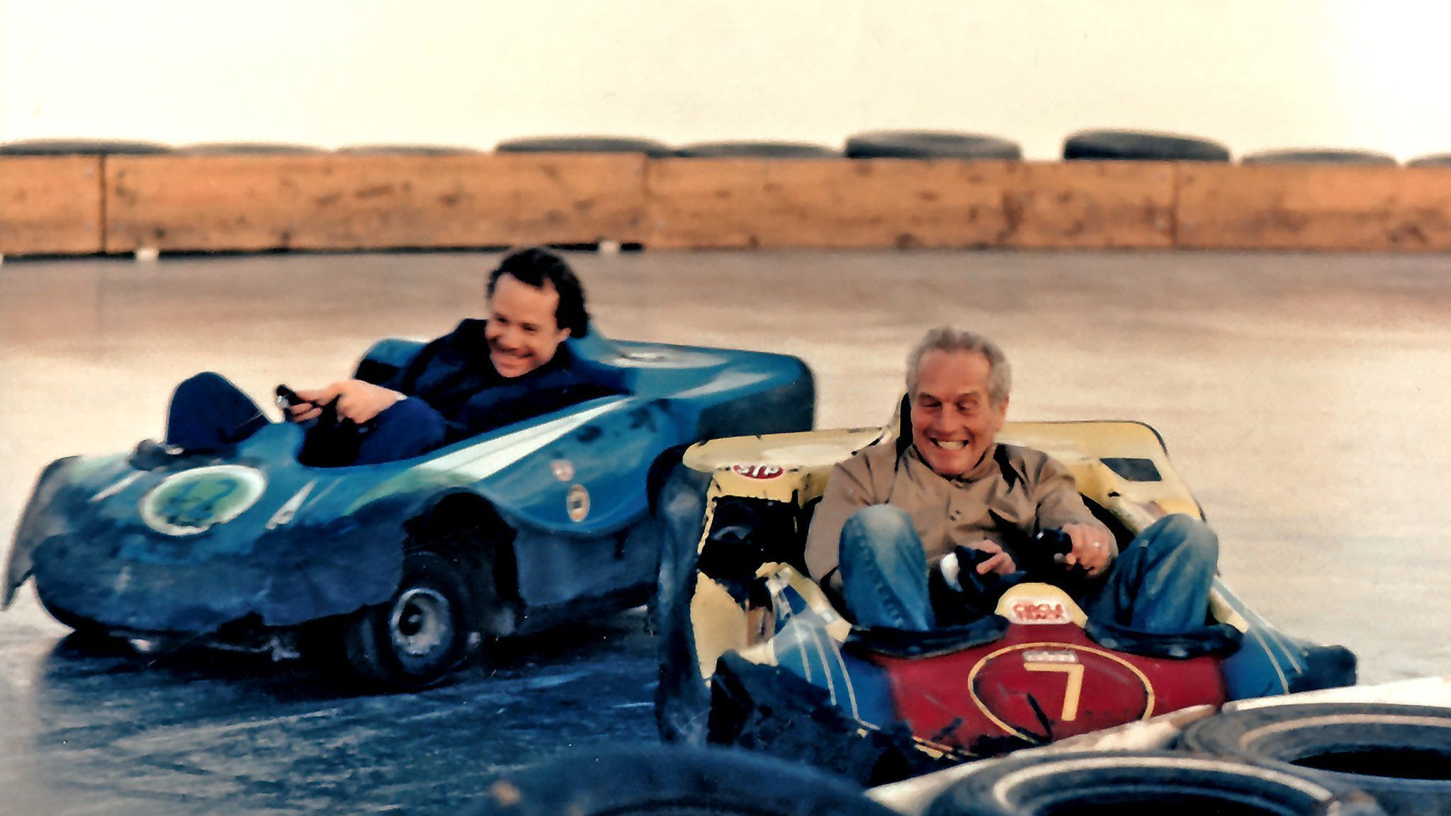 Paul Newman beating me to the finish line at a slick track in Los Angeles.