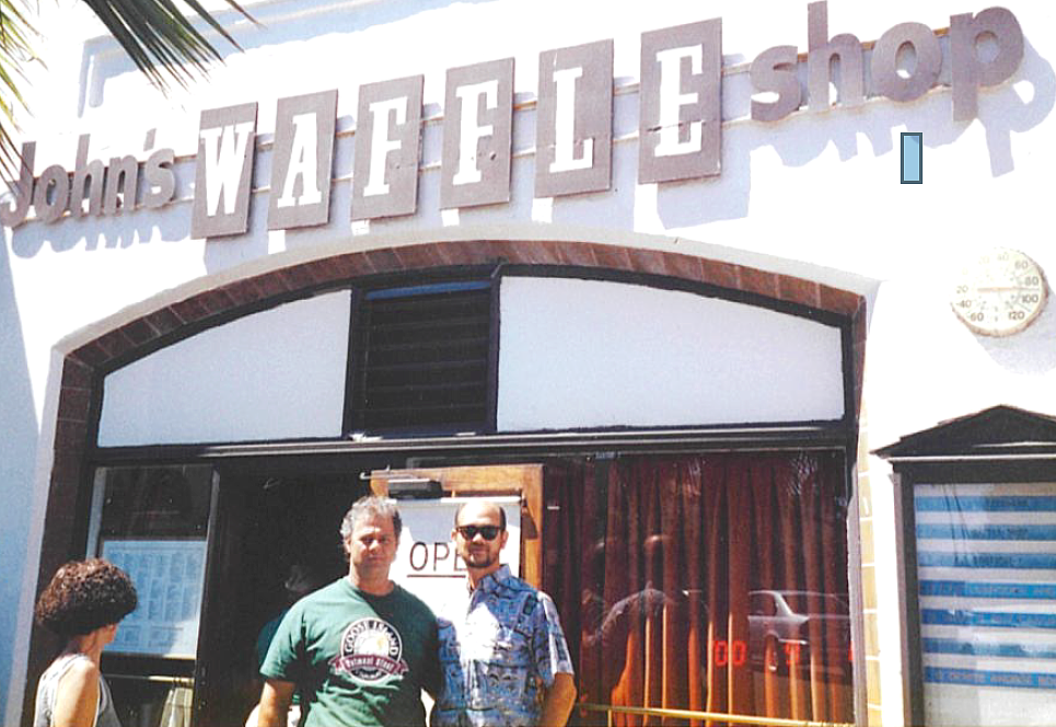 Dannie, right, and his older brother Michael (who died four years ago) pose in front of John's Waffle Shop shortly before it closed in 2000.