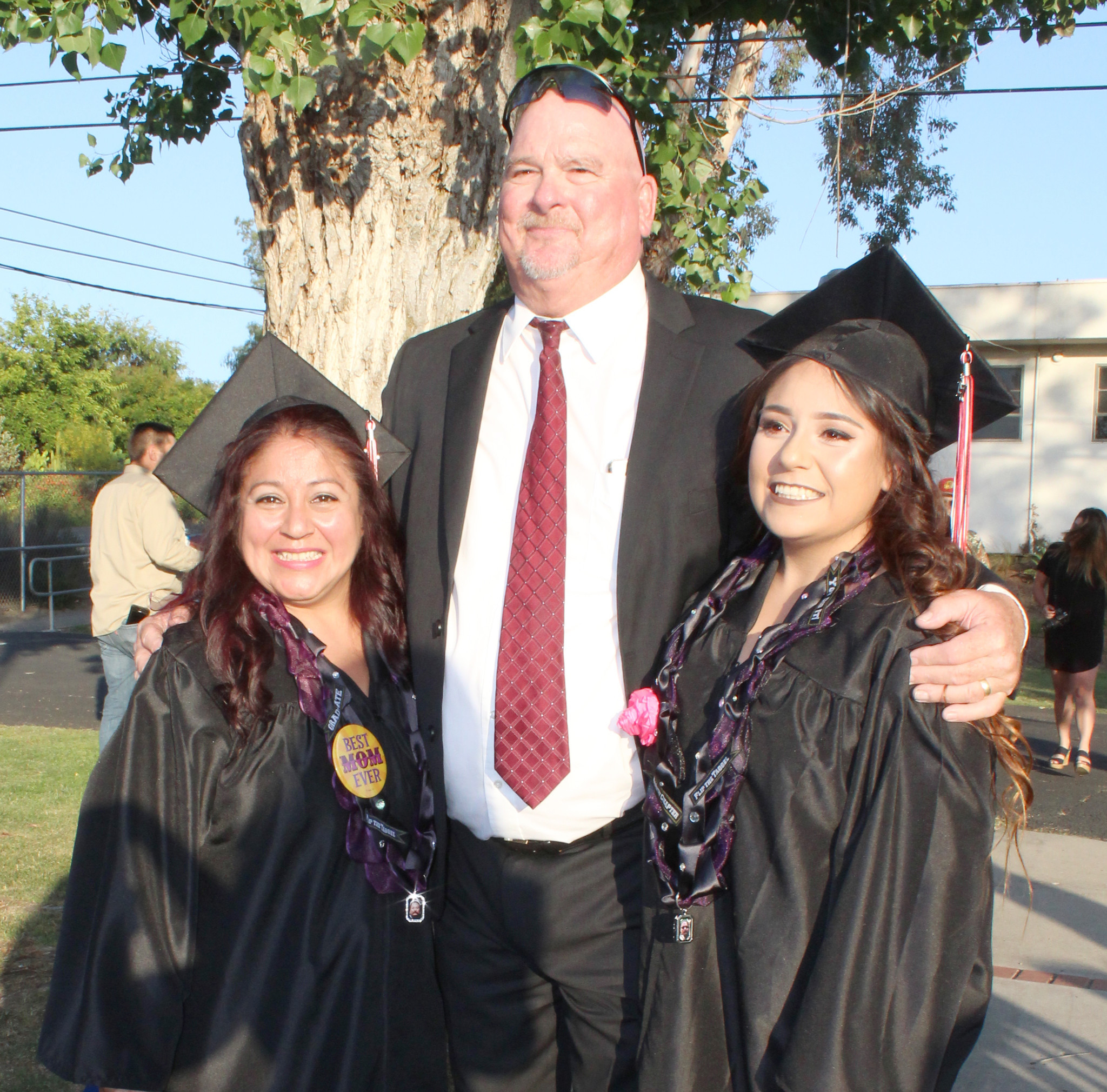 Dave Lohman congratulates mother and daughter Yolanda and thalia Cervantes, who graduated high school together in 2017.